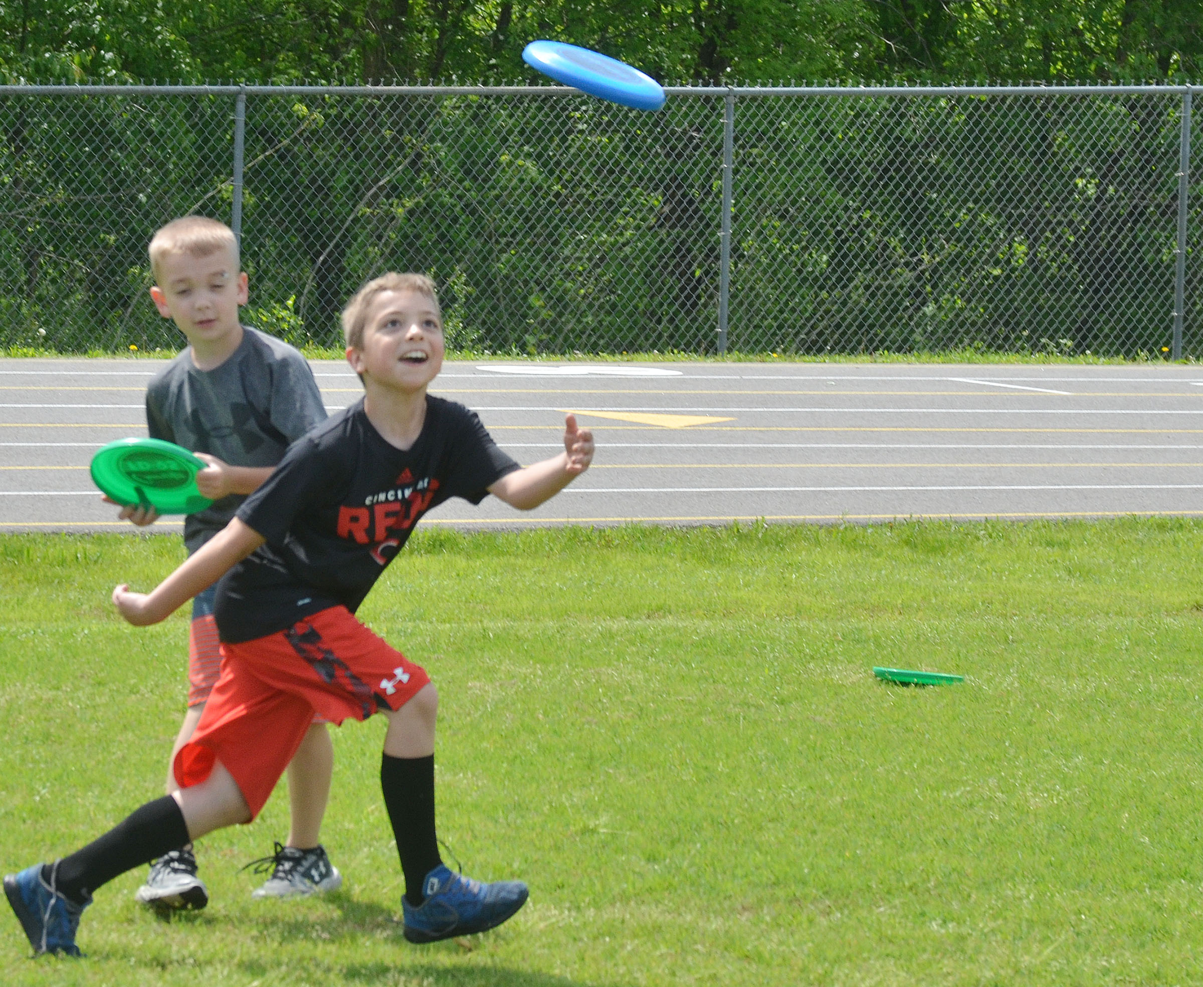CES third-grader Carson Mills catches a Frisbee.
