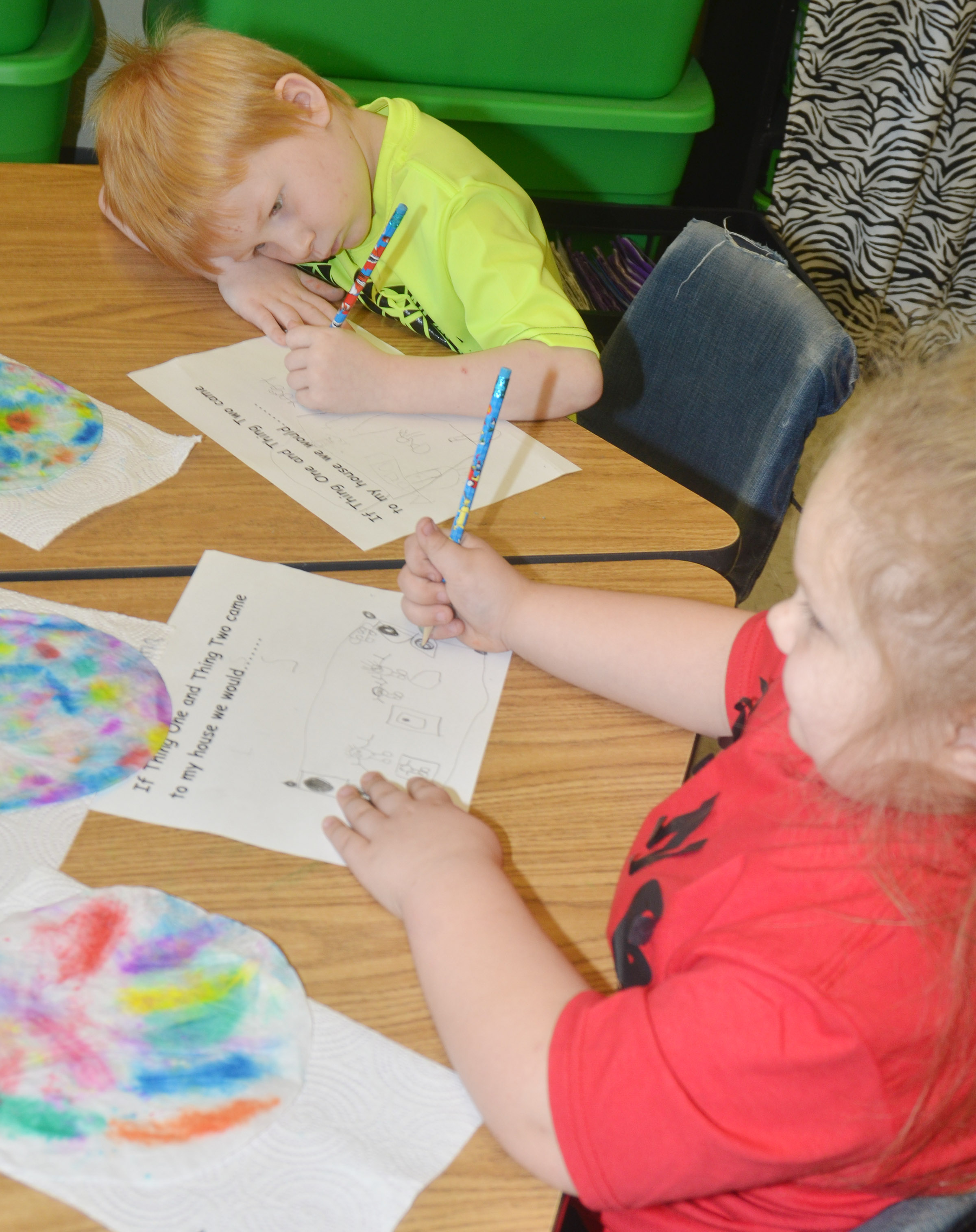 CES kindergarteners Jayden Maupin and ReAnna Jeffries write what they would do with Thing 1 and Thing 2.