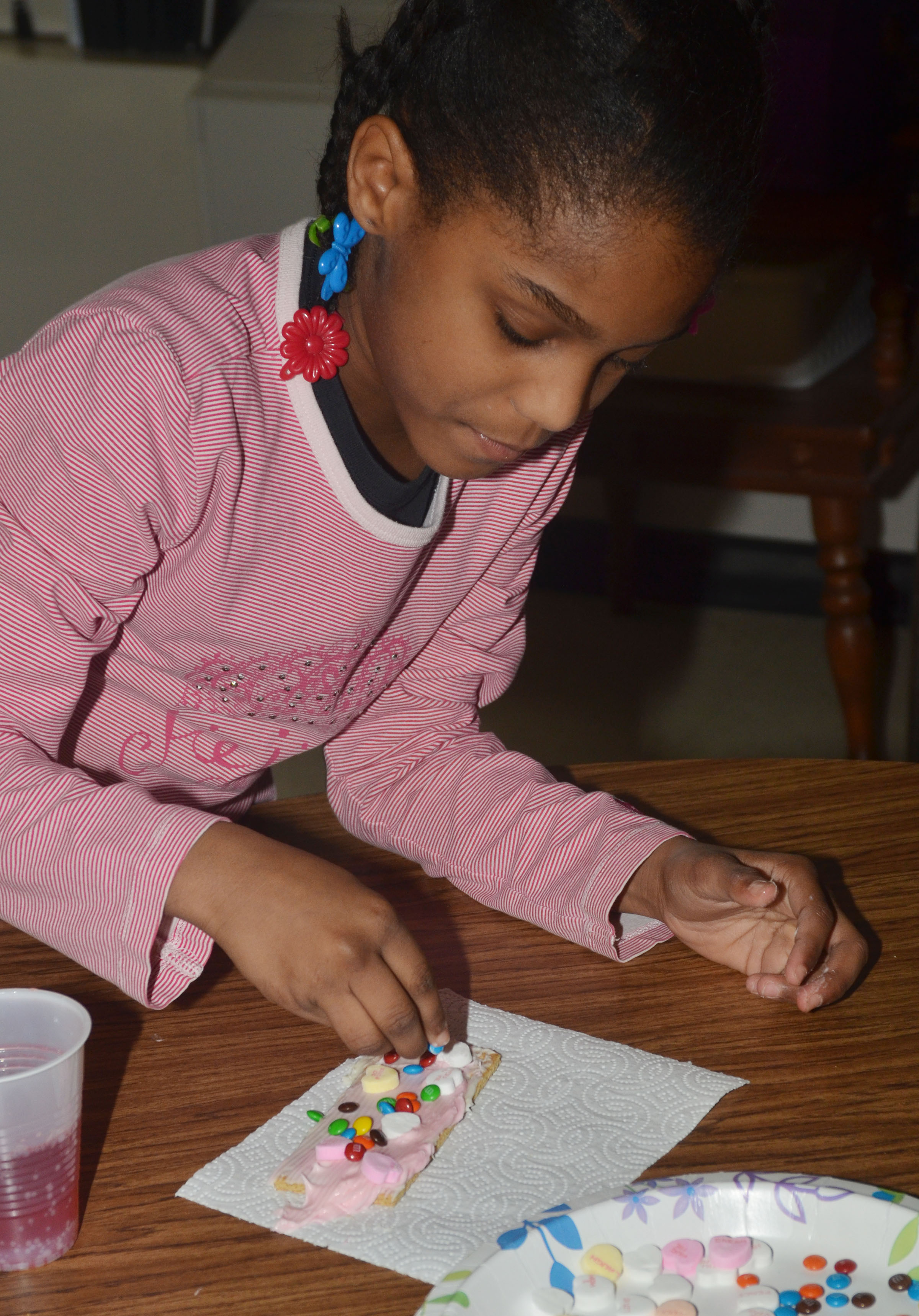 CES third-grader Maliyah Harris decorates her graham cracker.