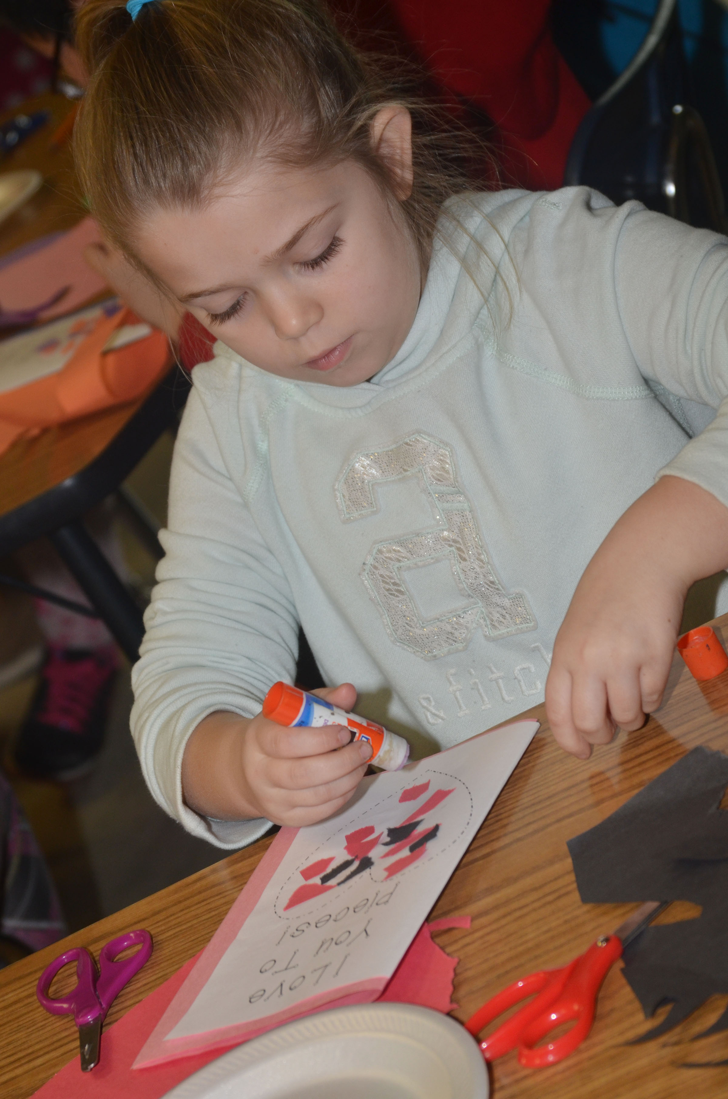 CES third-grader Chyanne Christie makes her Valentine card.