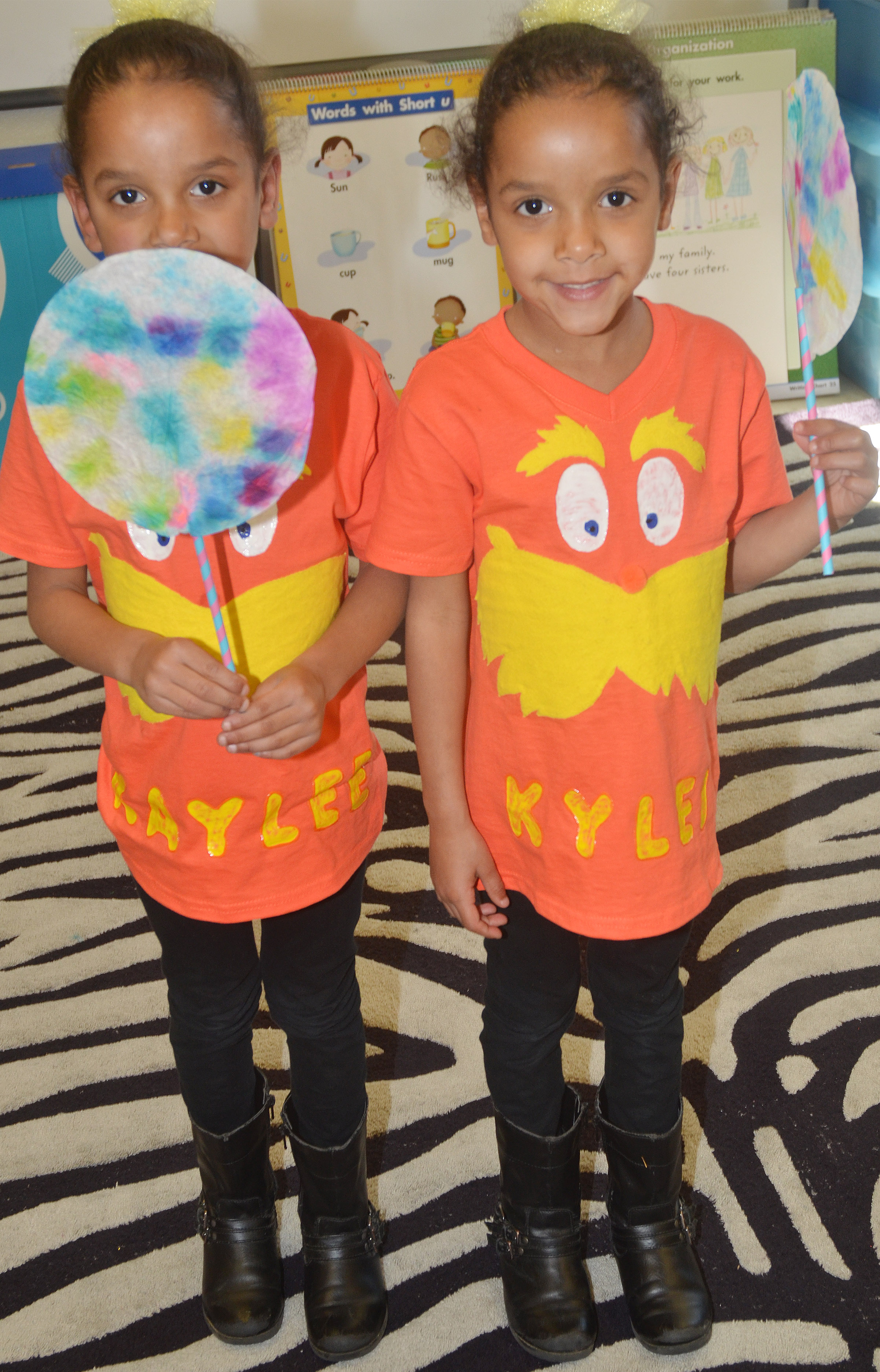 CES kindergartener Kaylee Thompson, at left, and her twin sister Kylei hold their truffula trees.