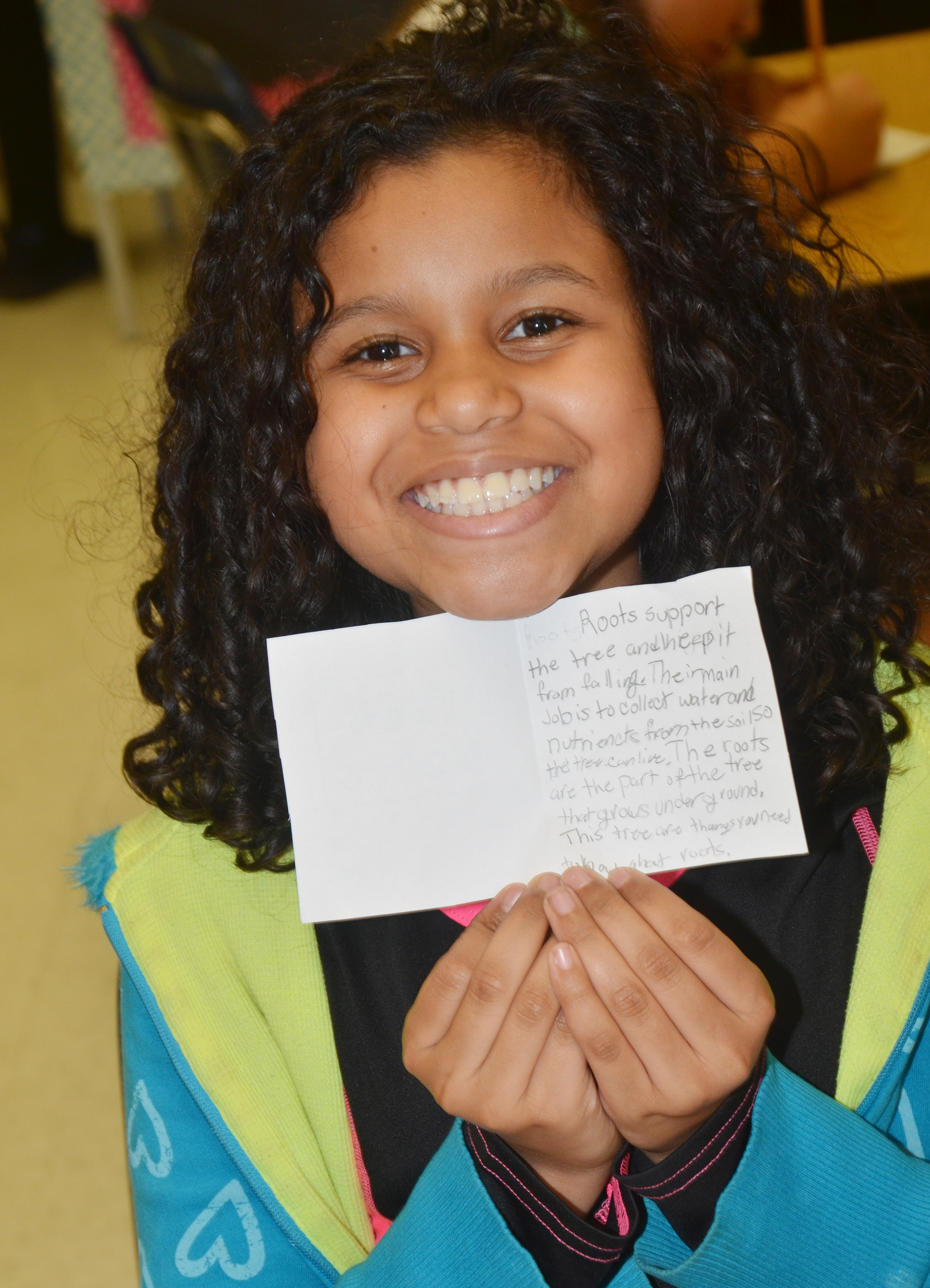 CES fifth-grader Destiny Bradley holds her mini-book.