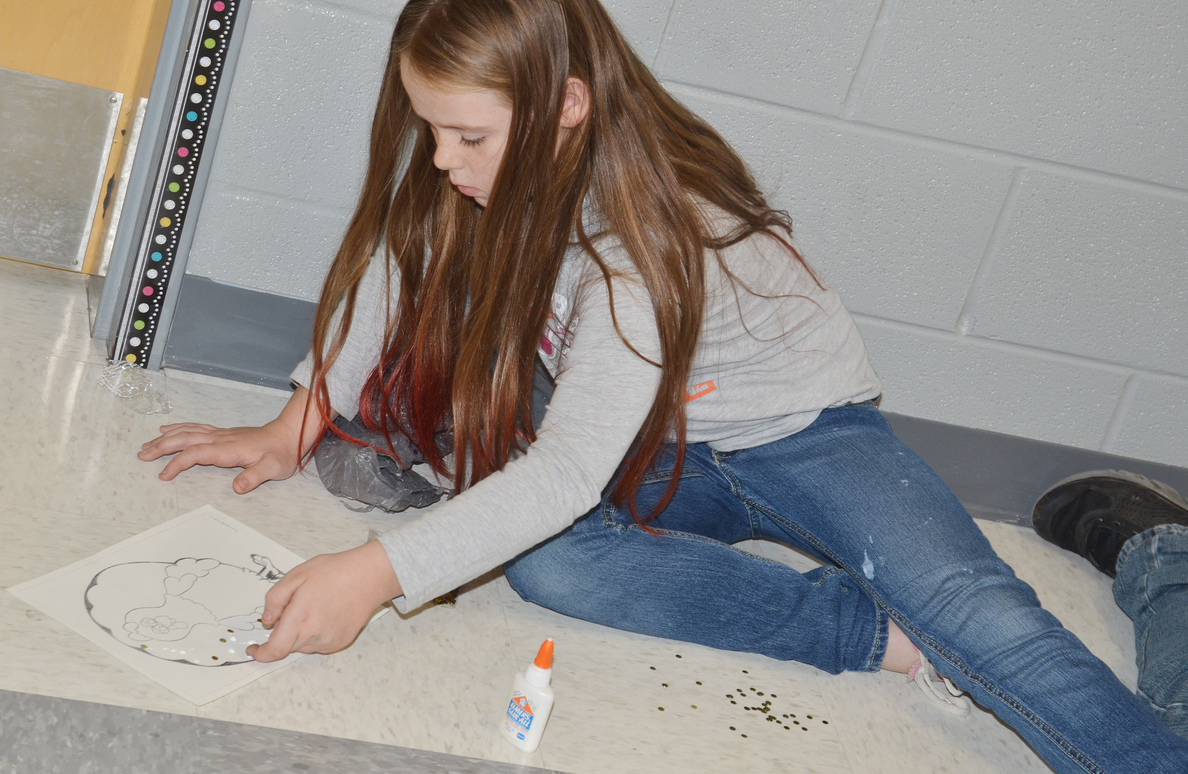 CES third-grader Cayleigh Underwood creates her turkey disguised as a rock star.