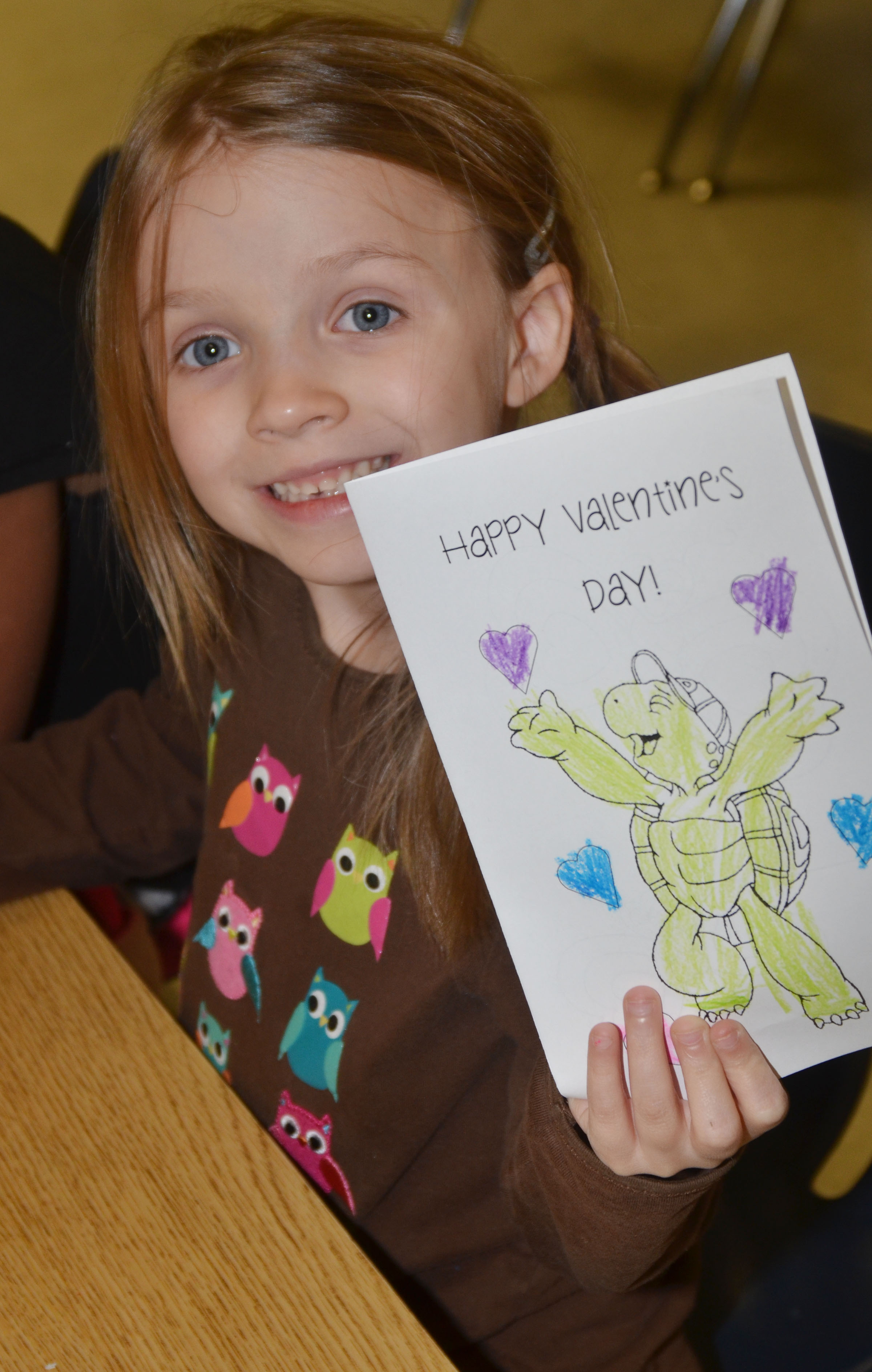 CES kindergartener Leah Covey holds her finished Valentine card.
