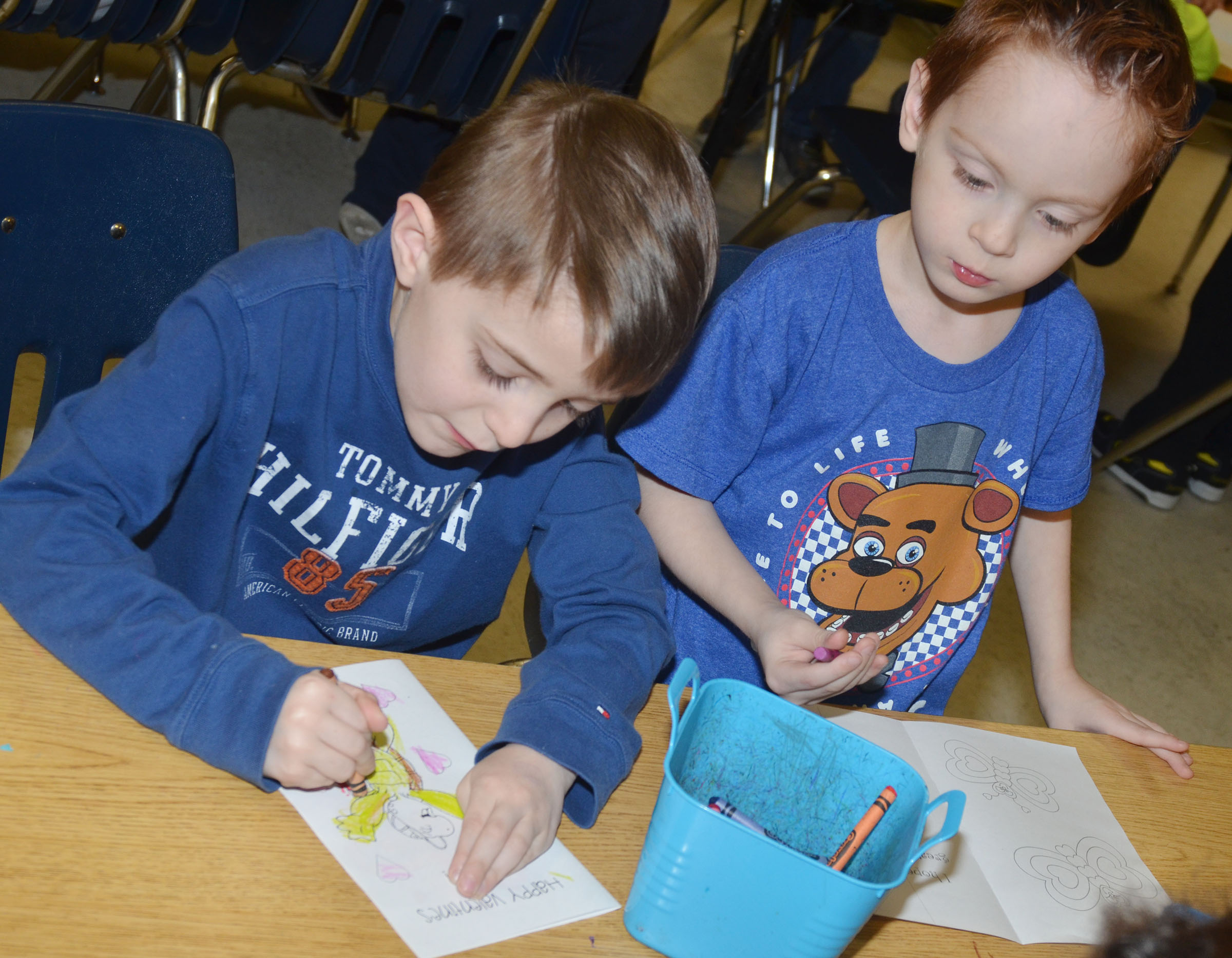 CES kindergarteners Caleb Goodson, at left, and Carson Montes color their Valentine cards.