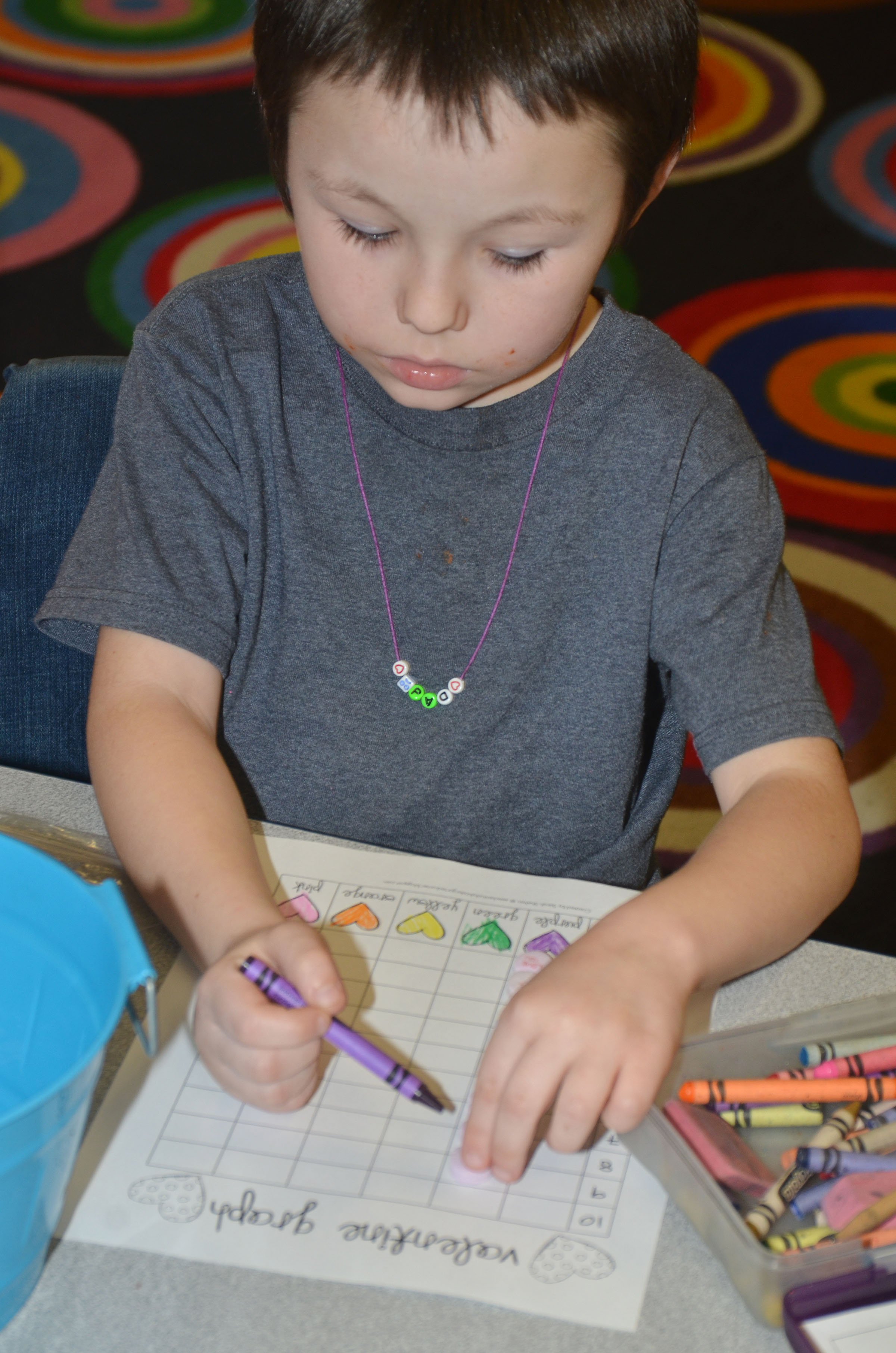 CES first-grader Joseph Boudreaux colors his graph.