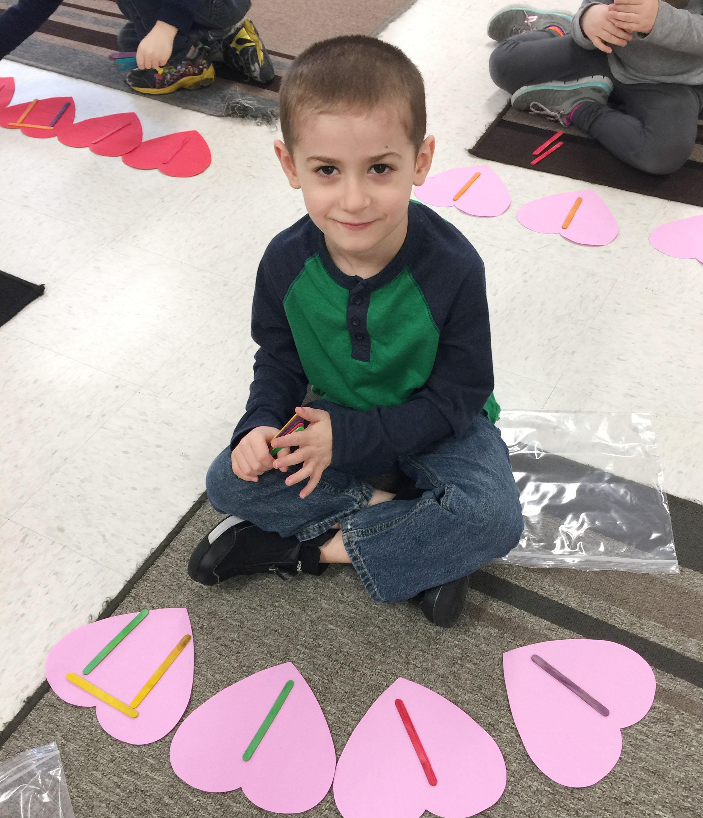CES kindergartener Greyson Trulock uses Popsicles to write his rhythms.