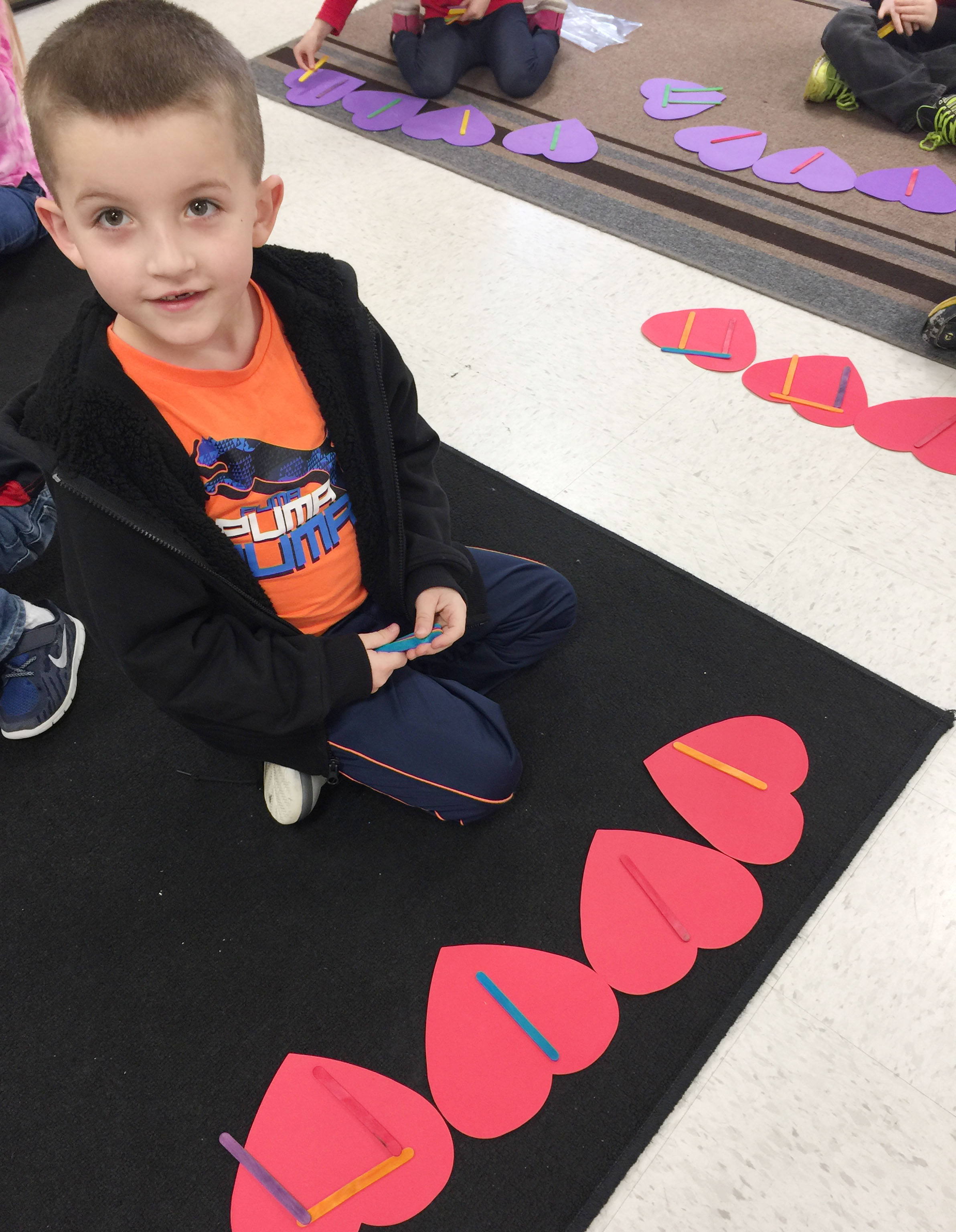 CES kindergartener Timothy Stacy uses Popsicles to write his rhythms.