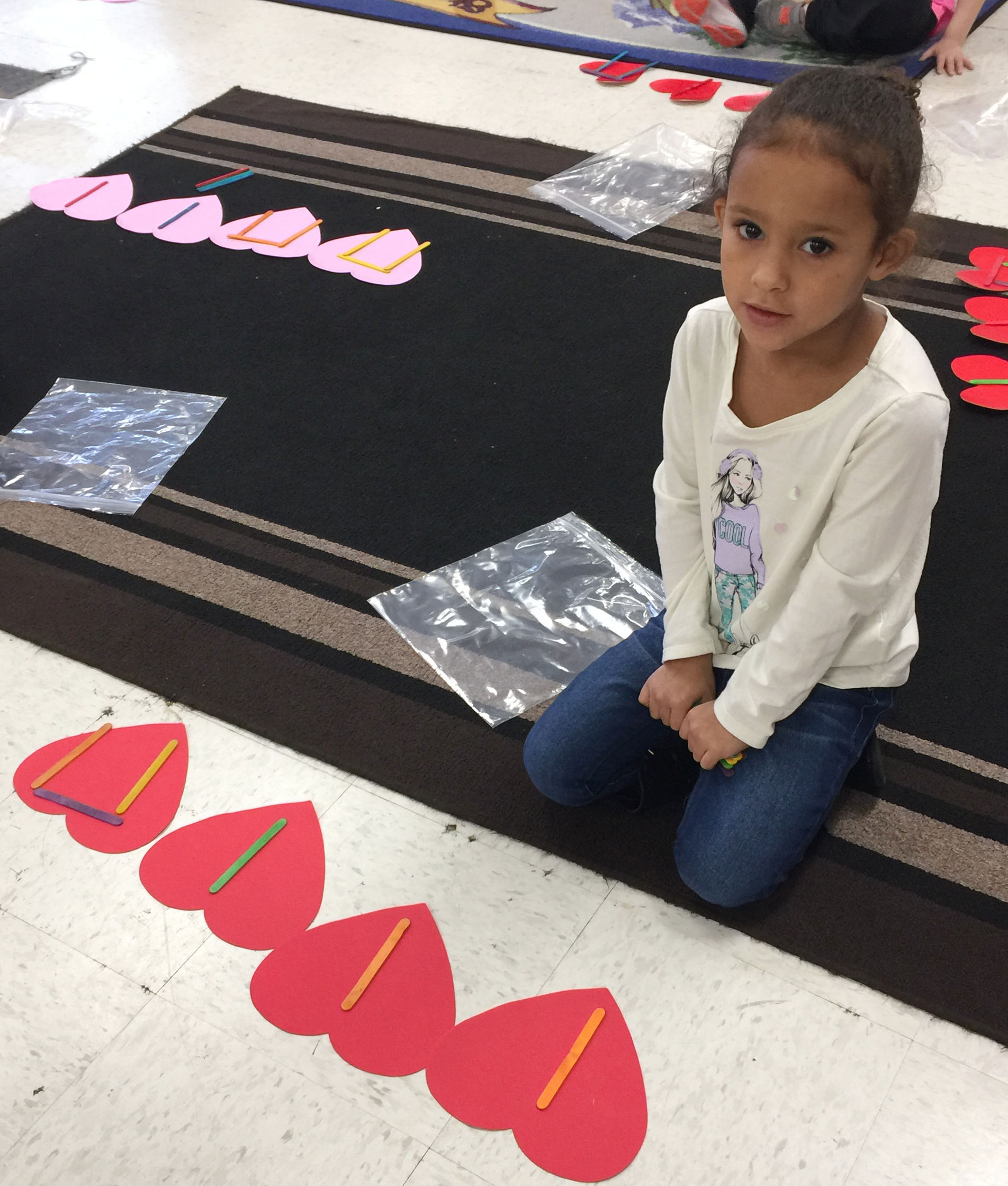 CES kindergartener Aleja Taylor uses Popsicles to write her rhythms.