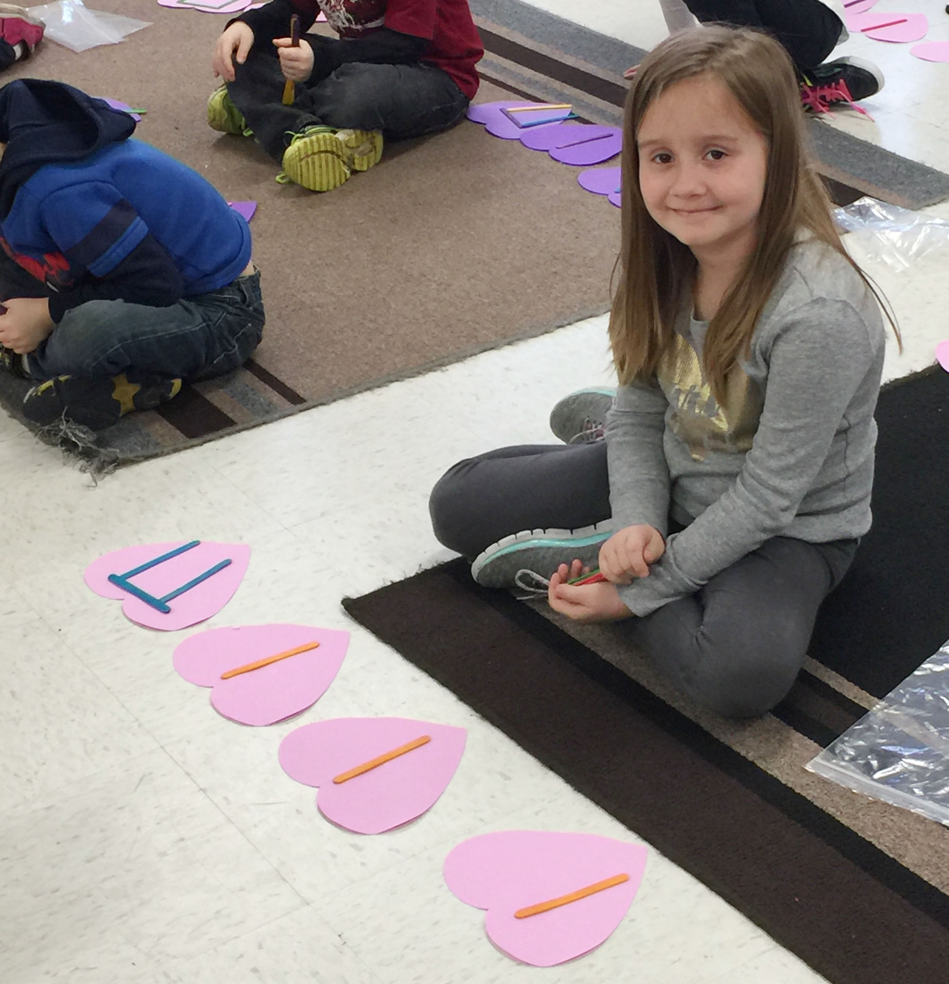 CES kindergartener Natalee Shaw uses Popsicles to write her rhythms.