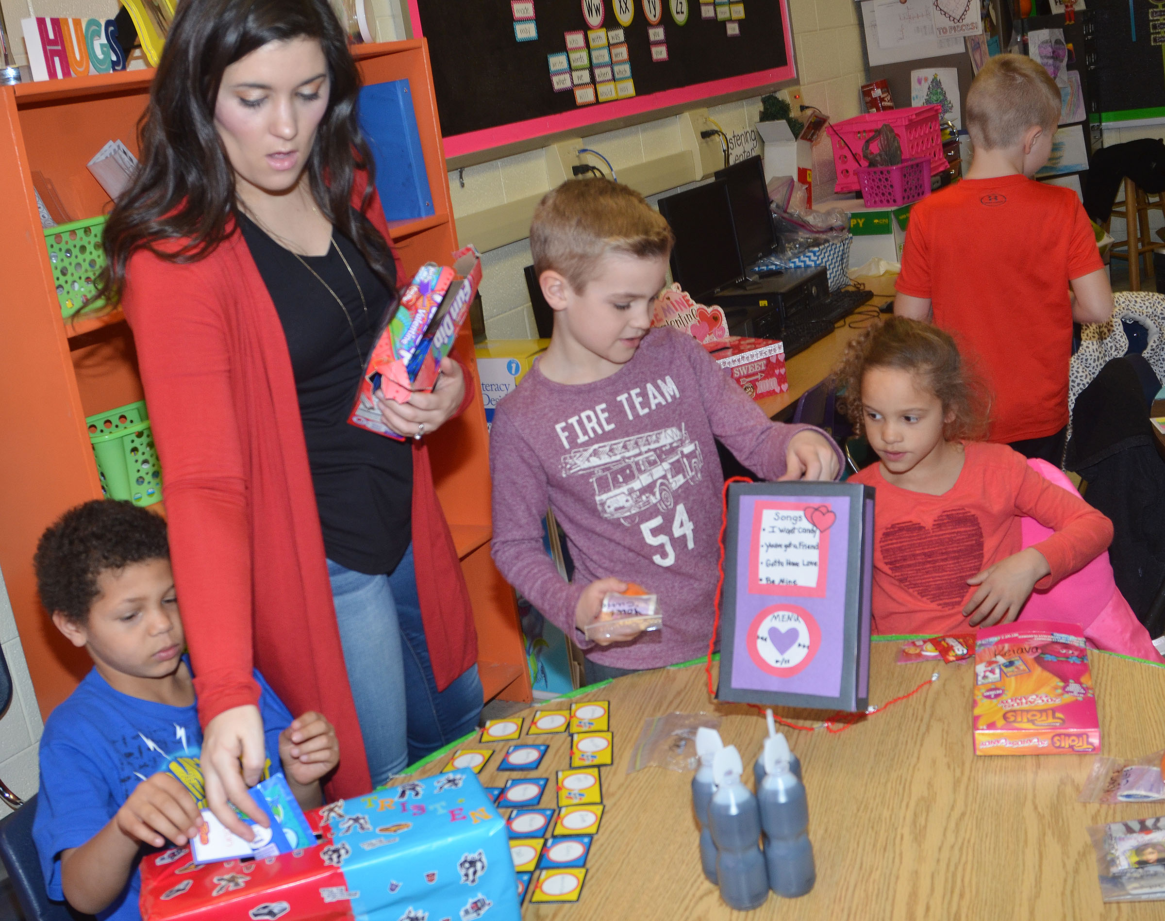 CES first-grade teacher Hailey Ogle passes out valentines to her students.