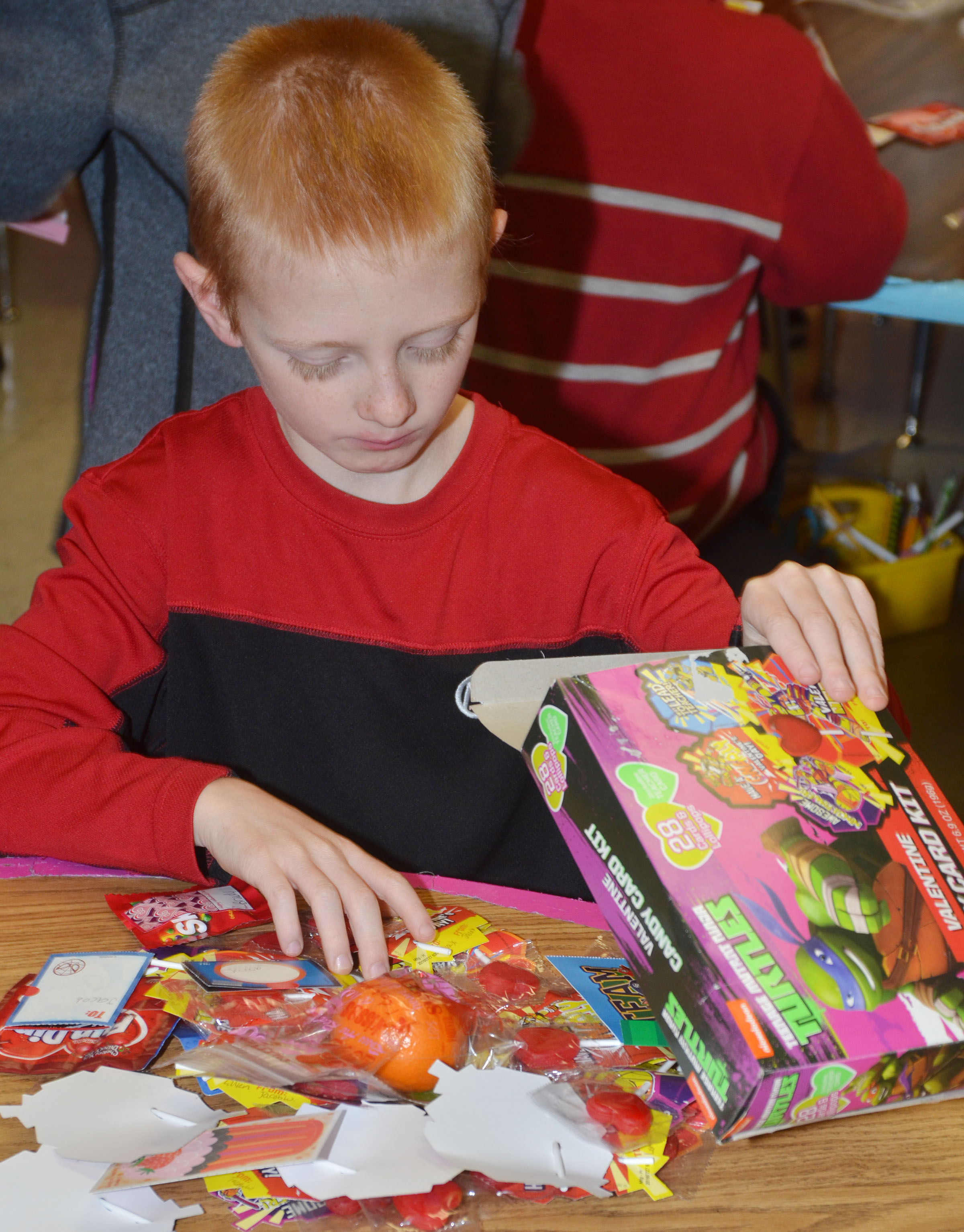 CES first-grader Jacob Wethington sorts through his valentines.