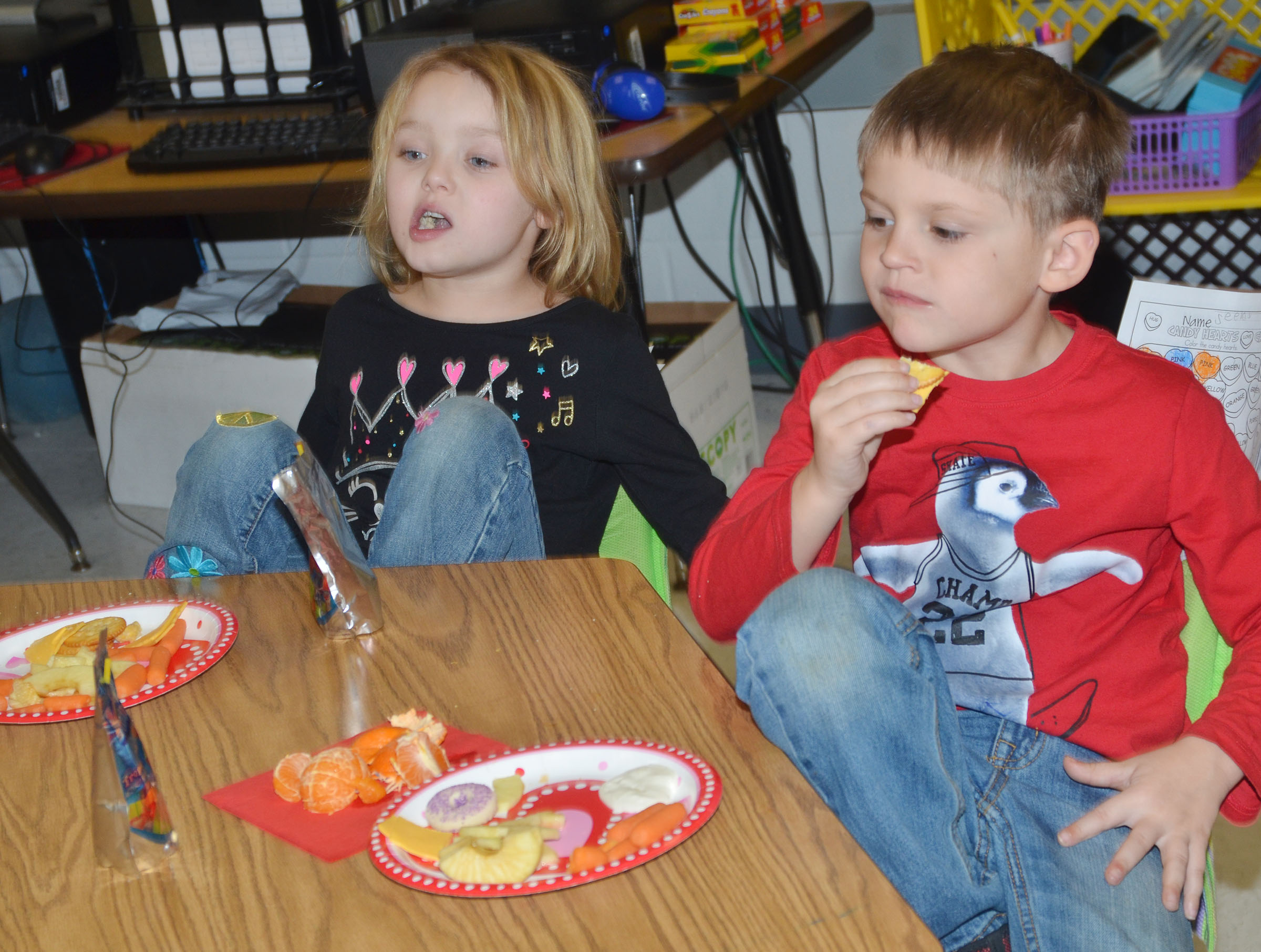 CES first-graders Mylee Bell, at left, and Seeley Whitaker enjoy snacks.