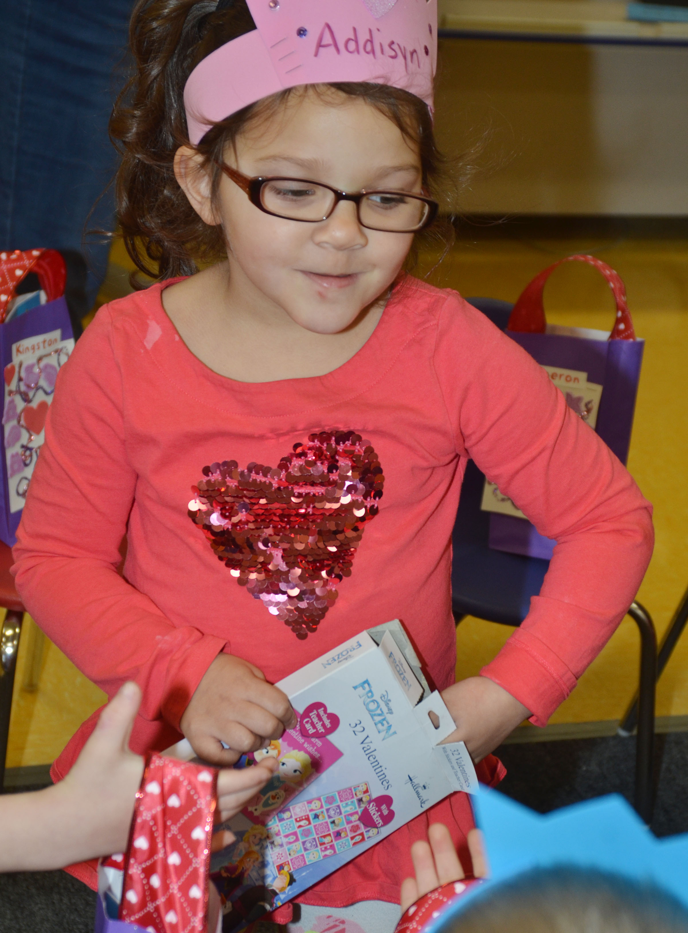 CES preschool student Addisyn Taylor passes out valentines.