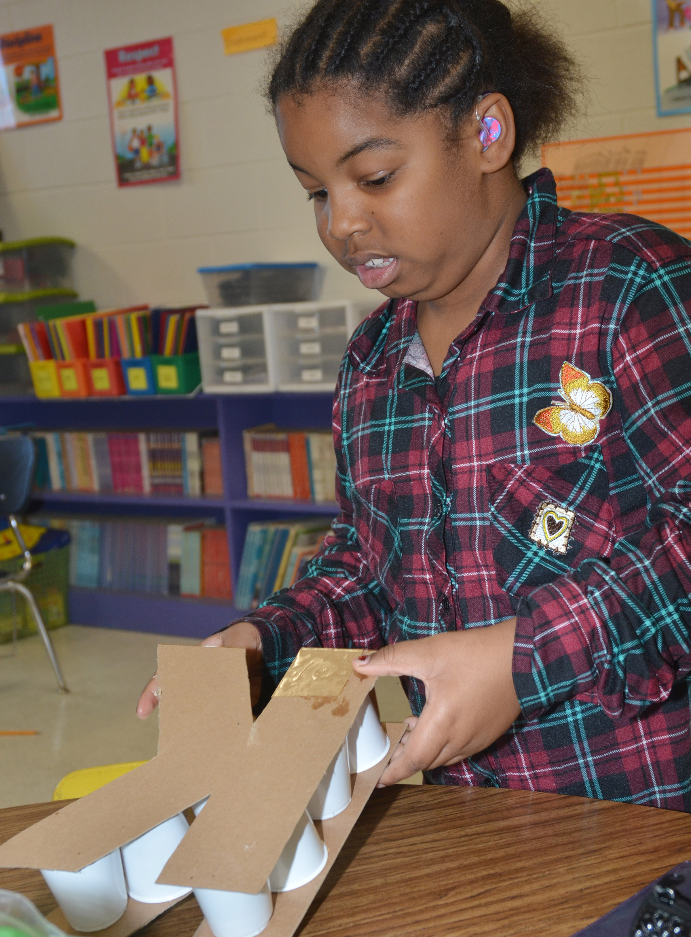 CES third-grader KaMiya Williams builds her 3D letter.
