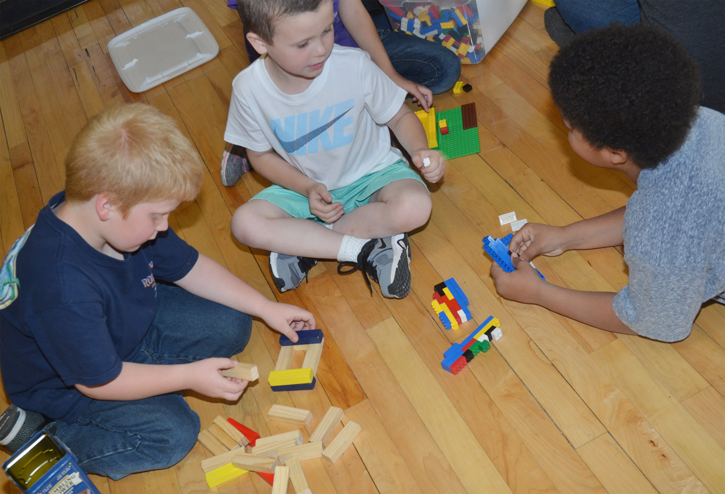 From left, first-grader Ben Parrott, kindergartener Braydan Dyer and first-grader Navon Copeland build with Legos and blocks.
