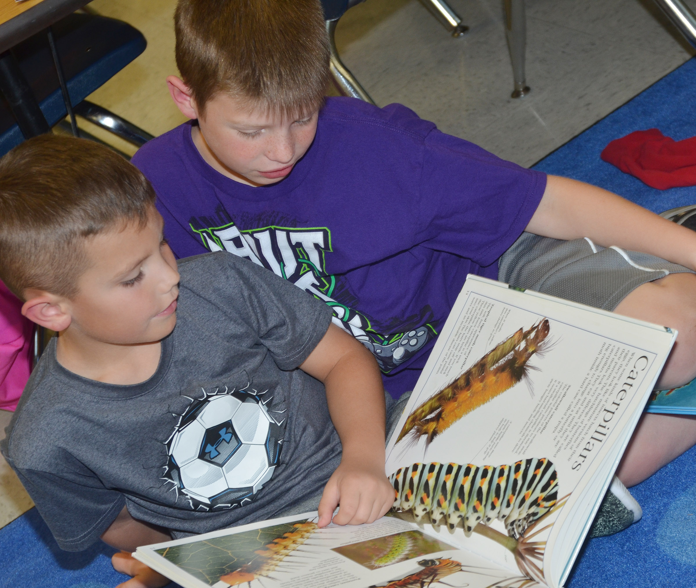 CES second-graders Owen Skaggs, at left, and Brody Sidebottom read together.