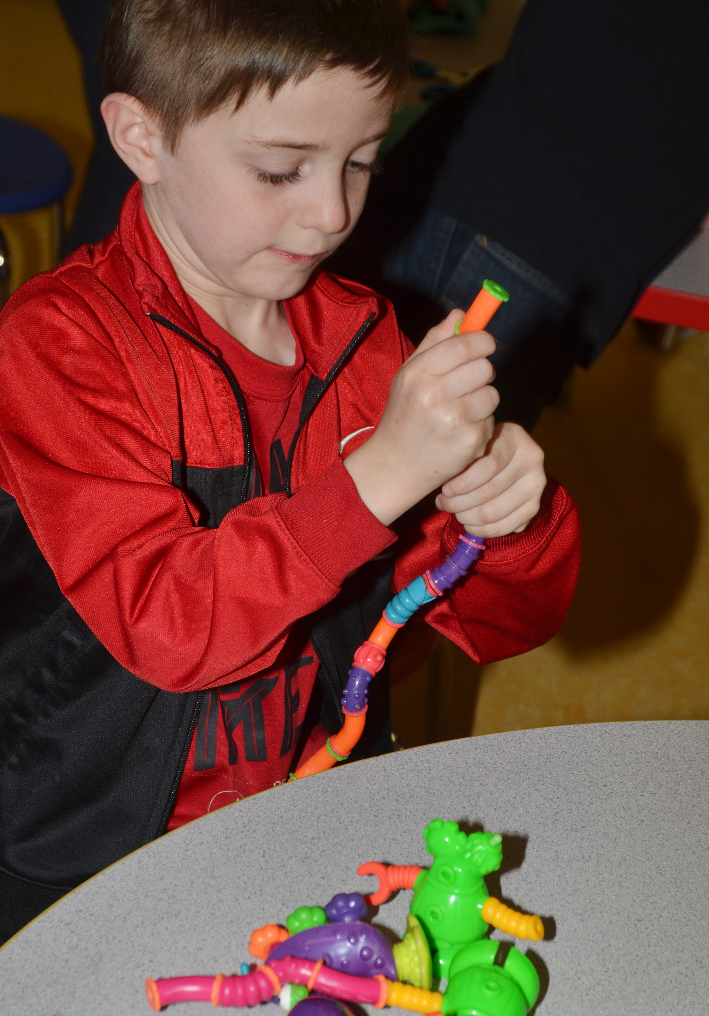 CES kindergartener Caleb Goodson puts his toys together.