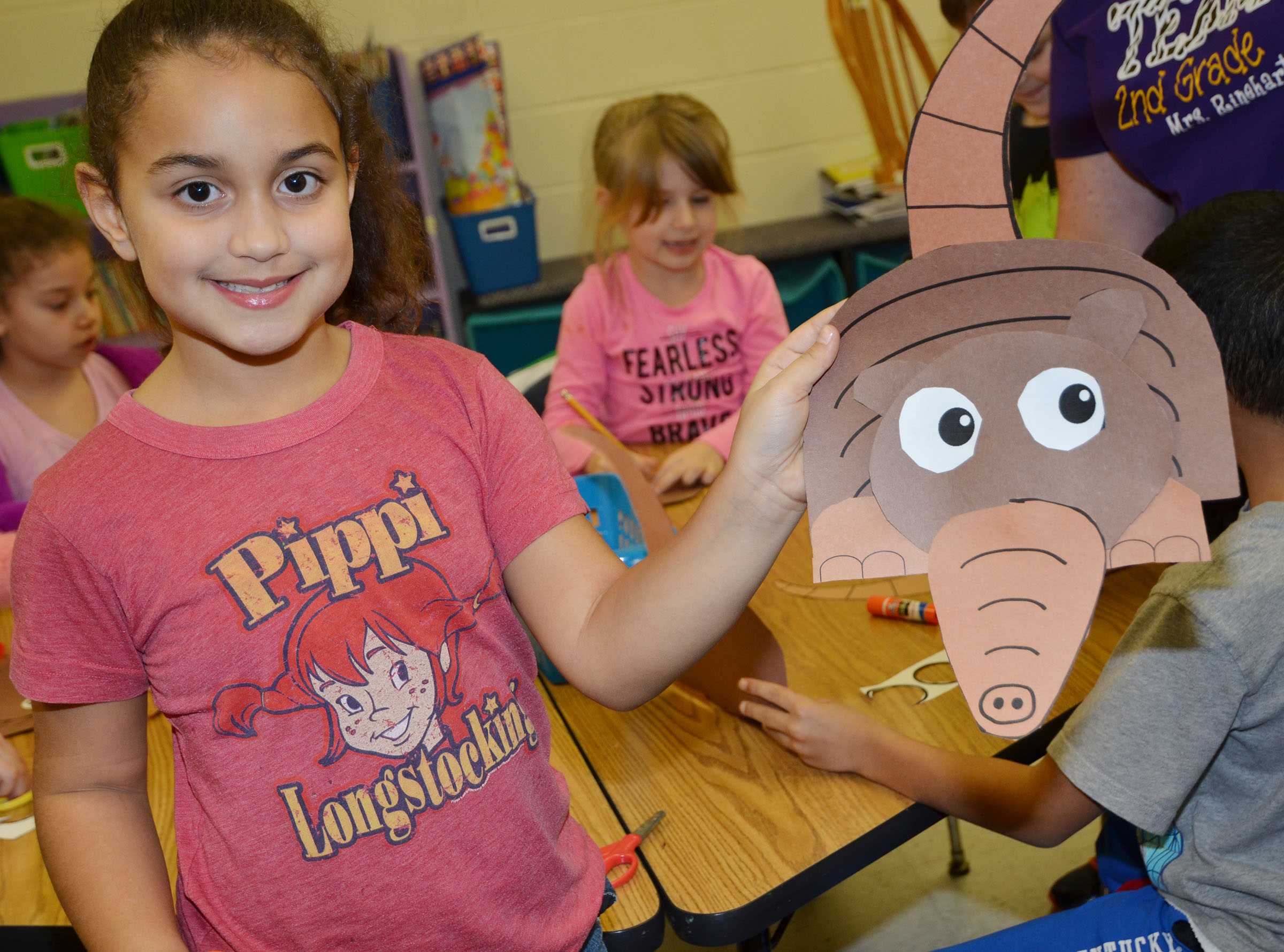 CES first-grader Maleigha Travis holds her finished armadillo.