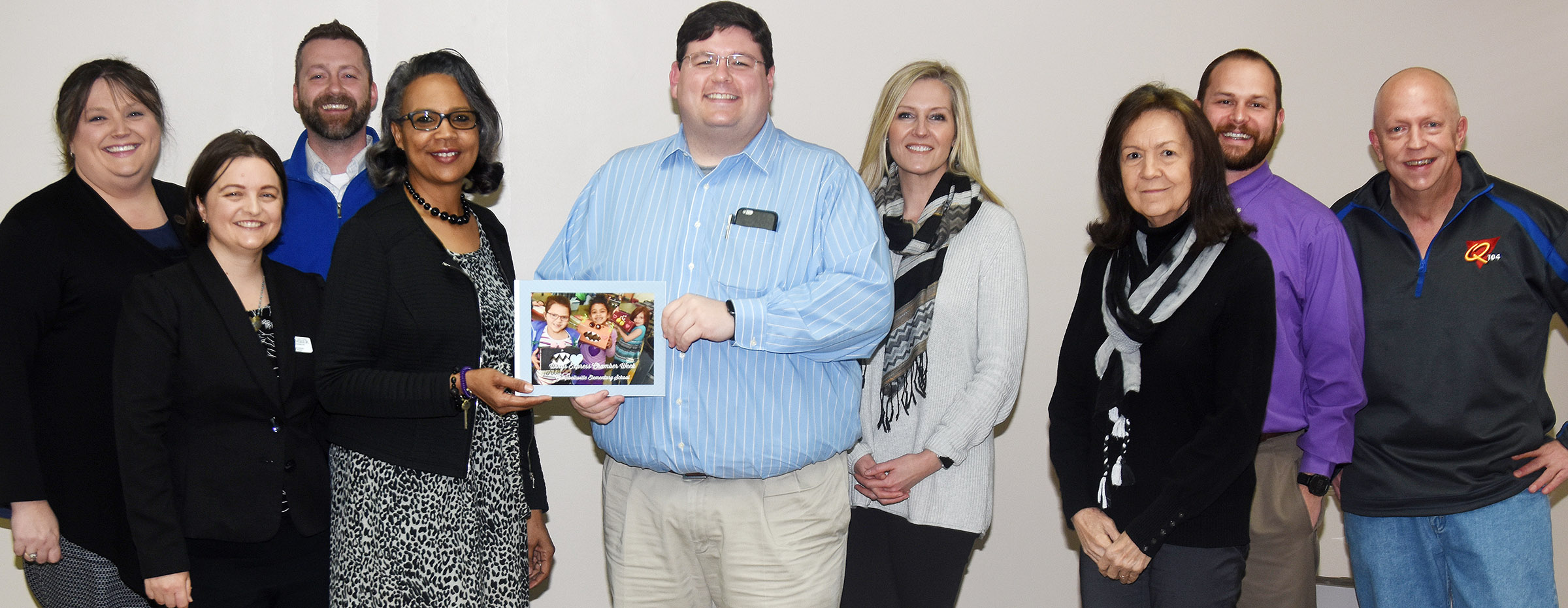 Campbellsville Elementary School Wings Express Director Doretha Sanders recently thanked community partners Campbellsville/Taylor County Chamber of Commerce Board members for hosting a week of special activities at the school. Sanders presented Board members with a book that features photos taken during the events. Pictured with Sanders are, from left, Board member Latasha Bell, Chamber Interim Director Niki Marineau, Board member Chad Shively, Sanders, Chamber Board President Jeremy Wood and Board members Leslie De Grez, Pat Cowherd, Austin Tedder and Rob Collins.