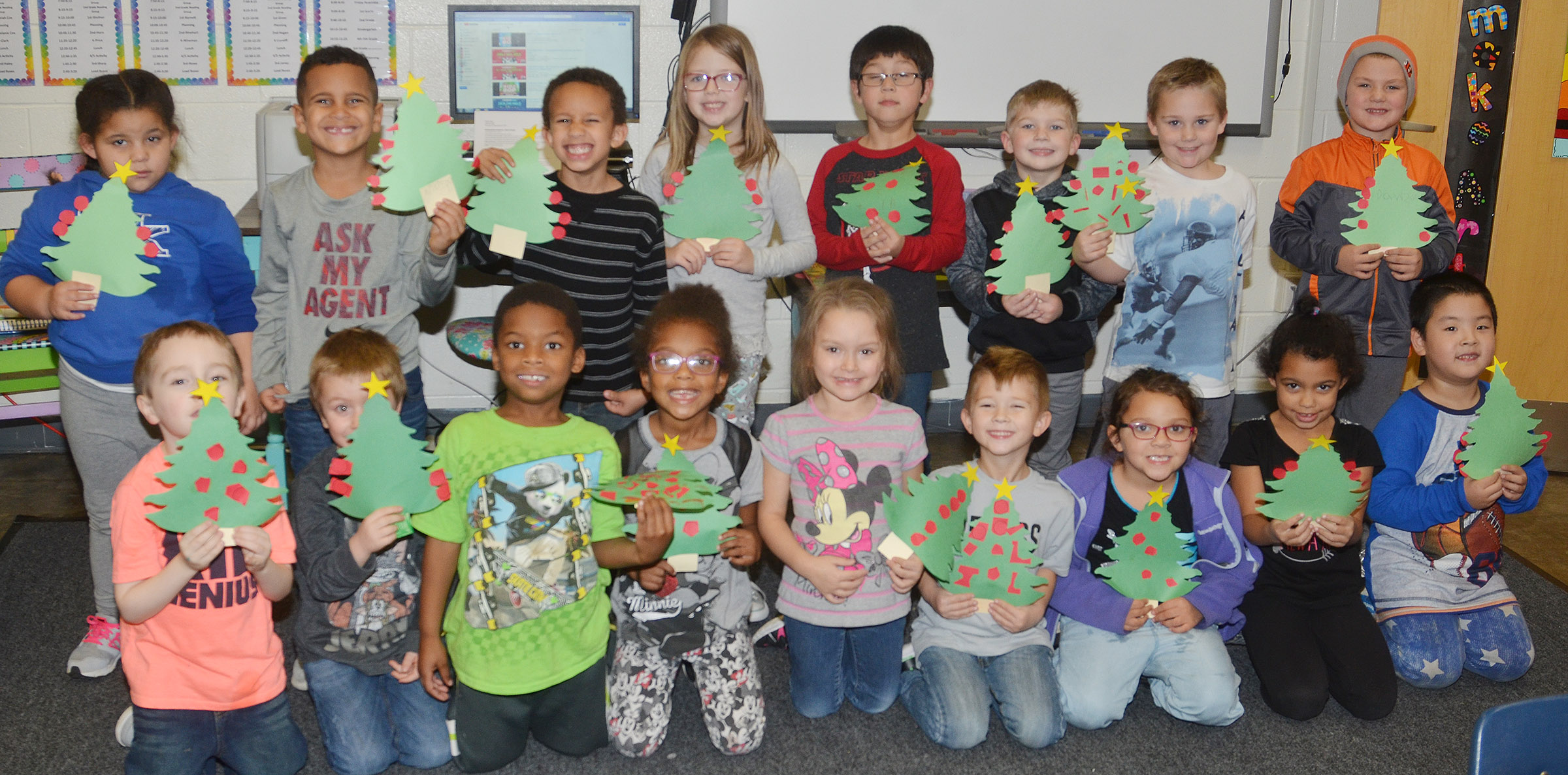 CES Wings Express kindergarten students hold their Christmas trees. From left, front, are Joshua Dickens, Alex Newcomb, Kaiyden Vancleave, Daya Griffin, Miyah Learmond, Andrew Stout, Addisyn Taylor, Rylee Karr and William Li. Back, Tatum Hoskins, Kingston Cowherd, Jaxon Williams, Emmaline Vespie, Victrin Ramsey, Landry Brown, Jacob Sandidge and Dawson Morton.