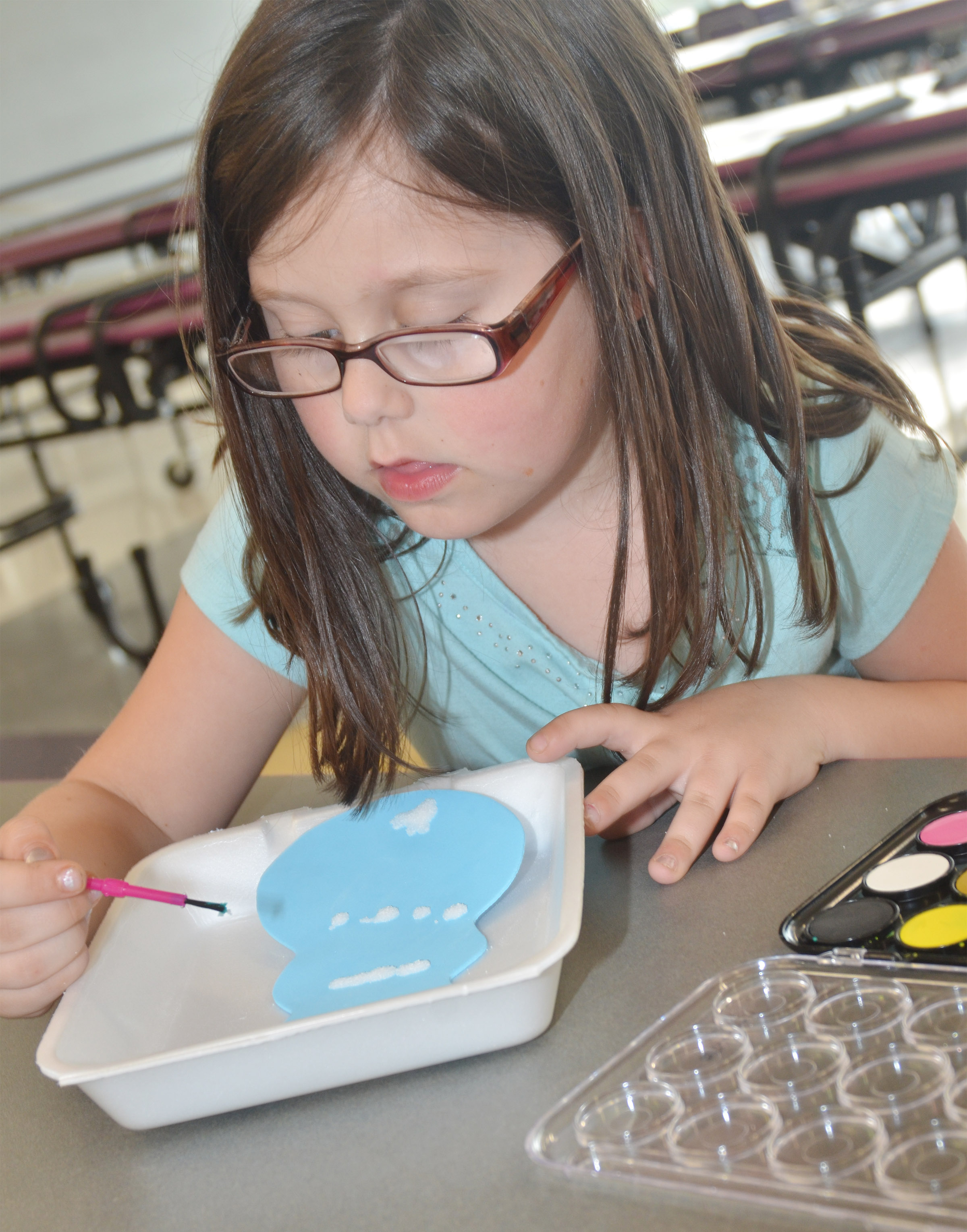 CES kindergartener Trinity Clark paints her rabbit.