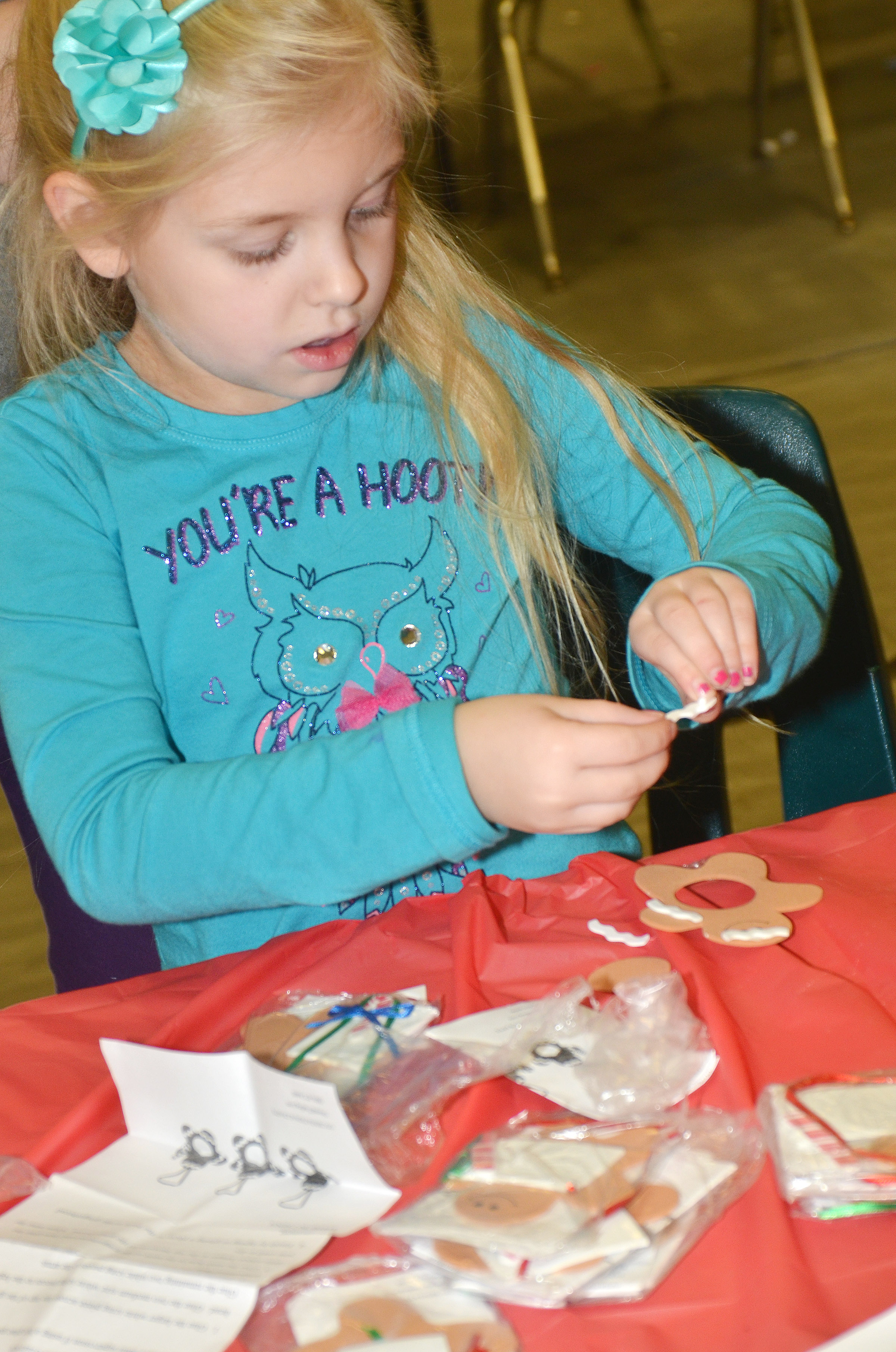 CES first-grader Aubrey Novak decorates an ornament.