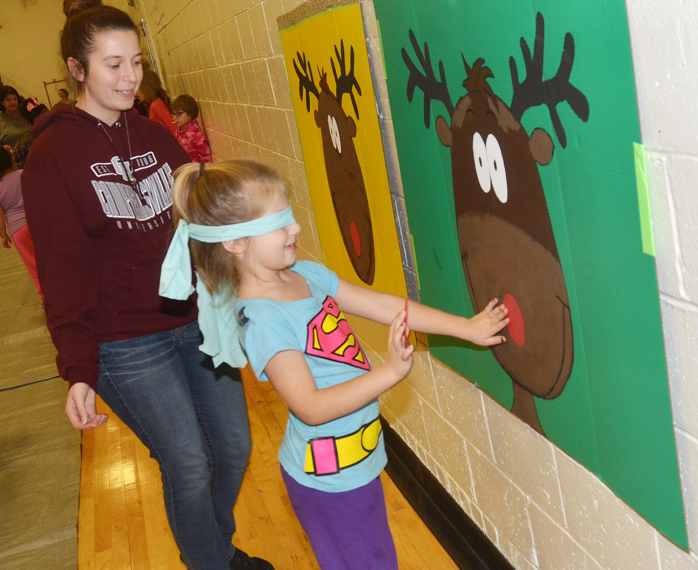 CES second-grader Kenady Hayes plays pin the tail on the reindeer.
