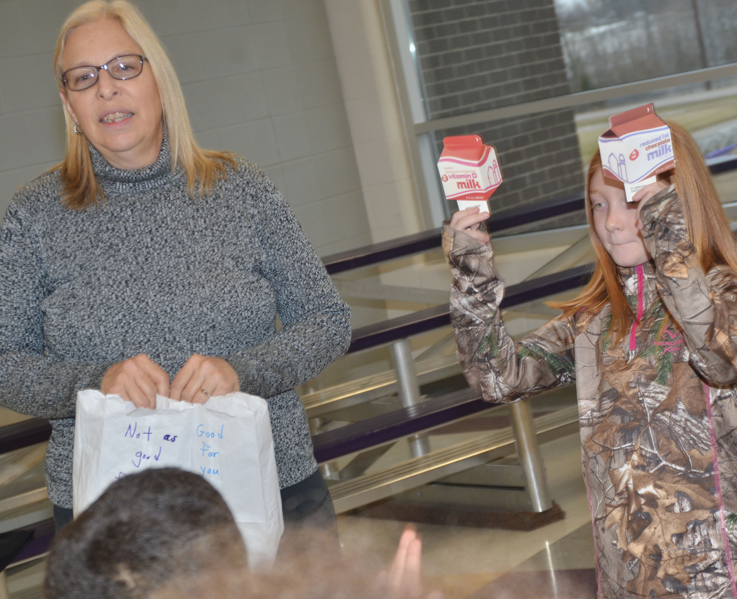 CES third-grader Savannah Wethington and Angie Freeman, expanded foods and nutrition program assistant at Taylor County Extension Office, ask which is healthier, white milk or chocolate milk.