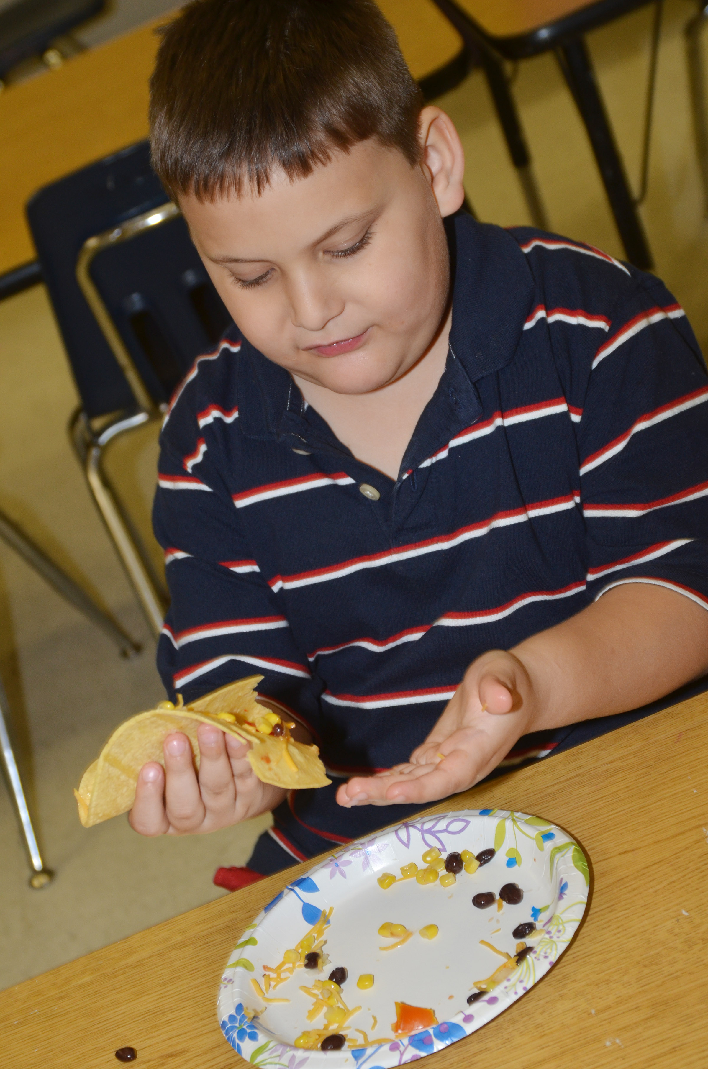 CES kindergartener Cloud Malone enjoys his Mexican pizza.