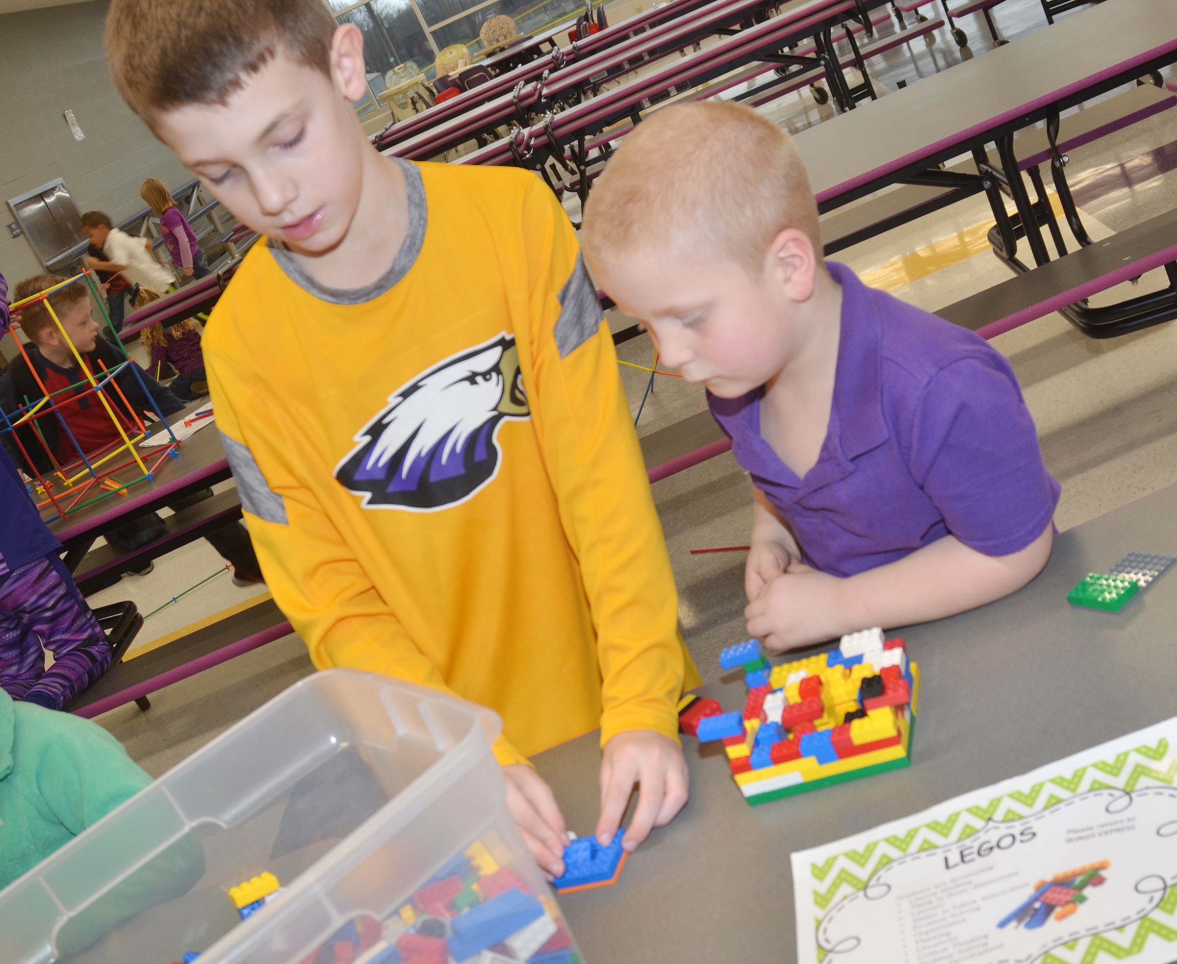 CES second-grader Aidan Wilson, at left, and first-grader Ben Parrott build with Legos.
