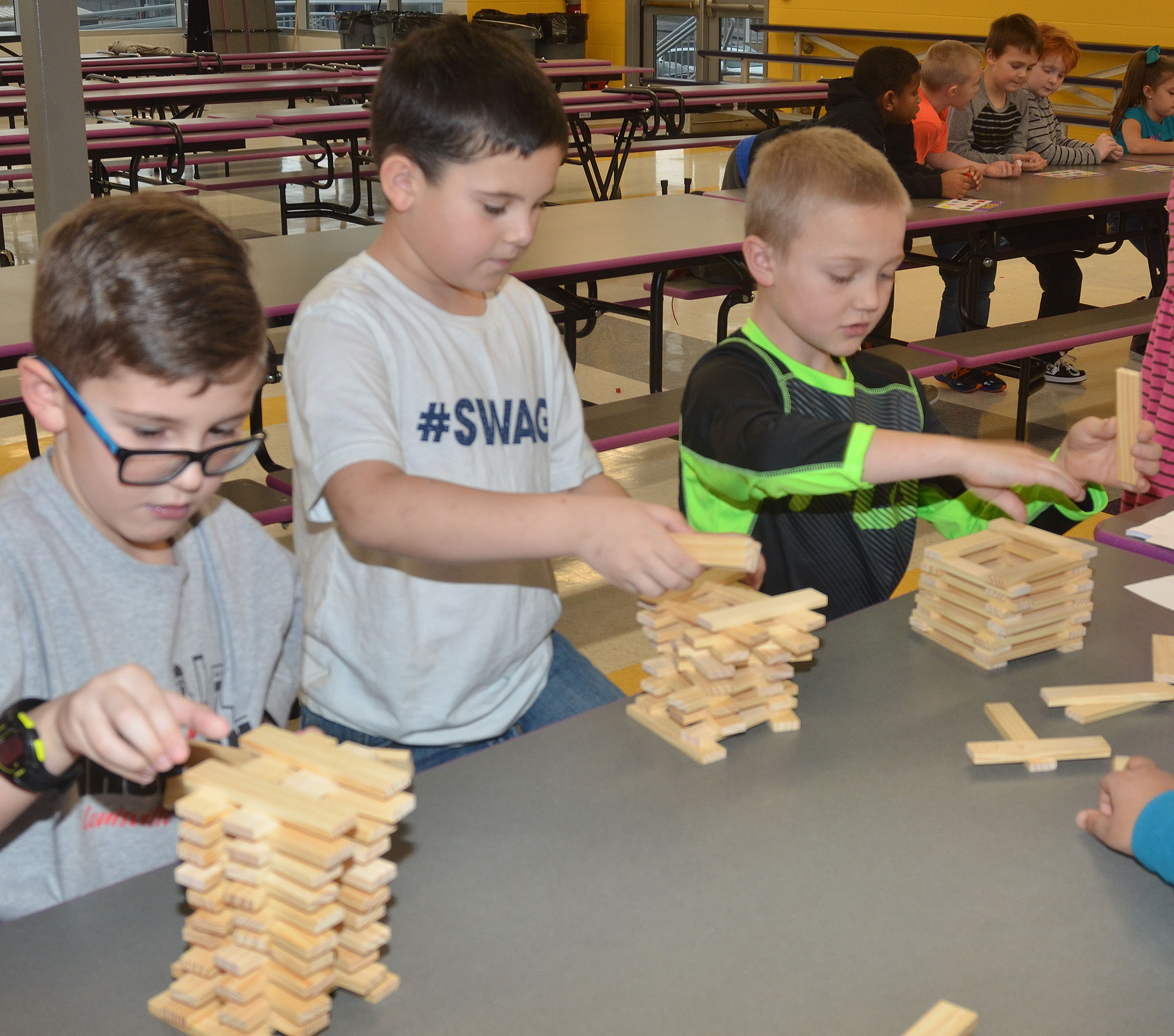 From left, CES second-graders Tye Rhodes, Damien Clark and Trenton Harris build with wooden blocks.