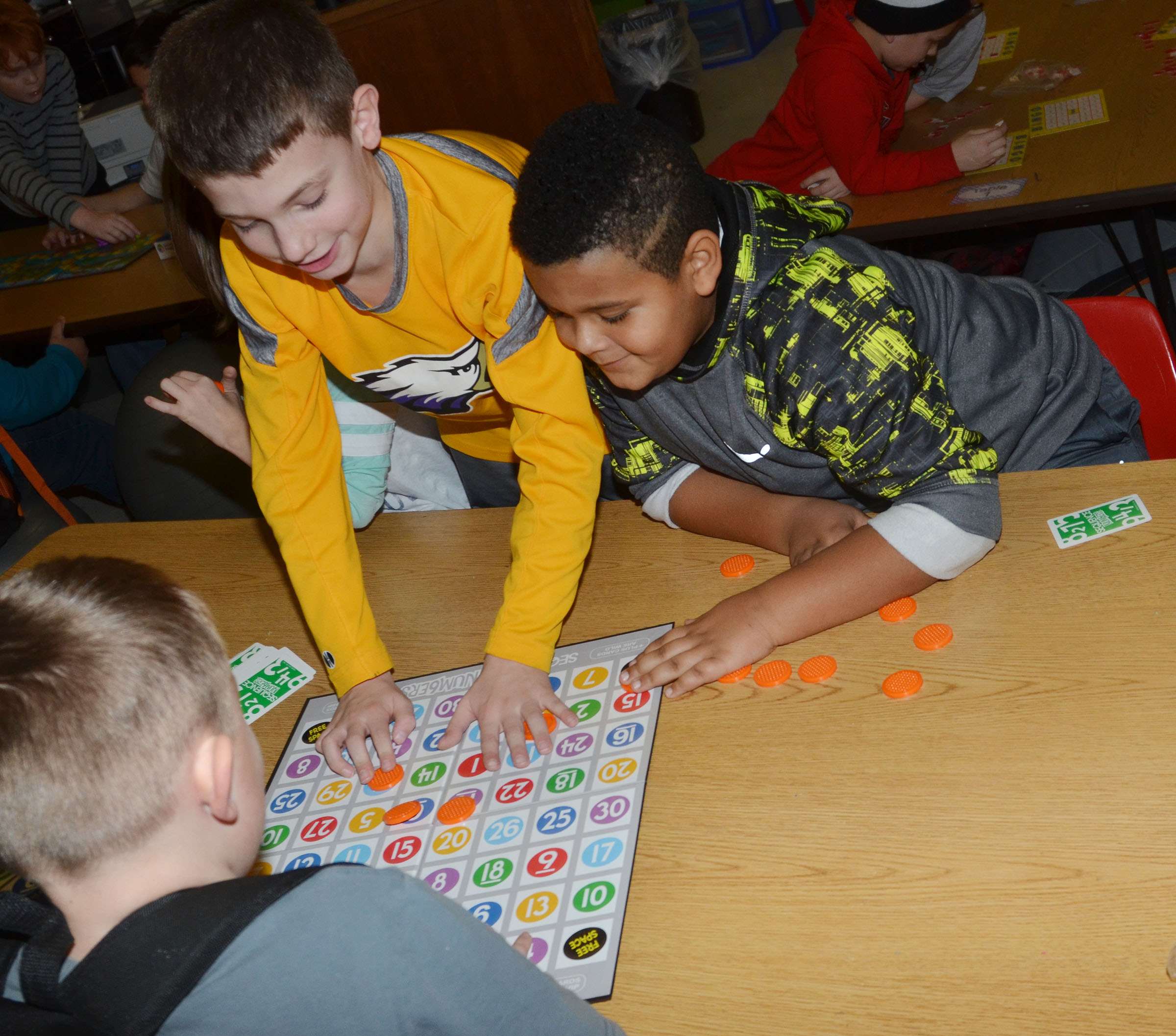 CES second-graders Aidan Wilson, at left, and Jayden Moore play a board game.