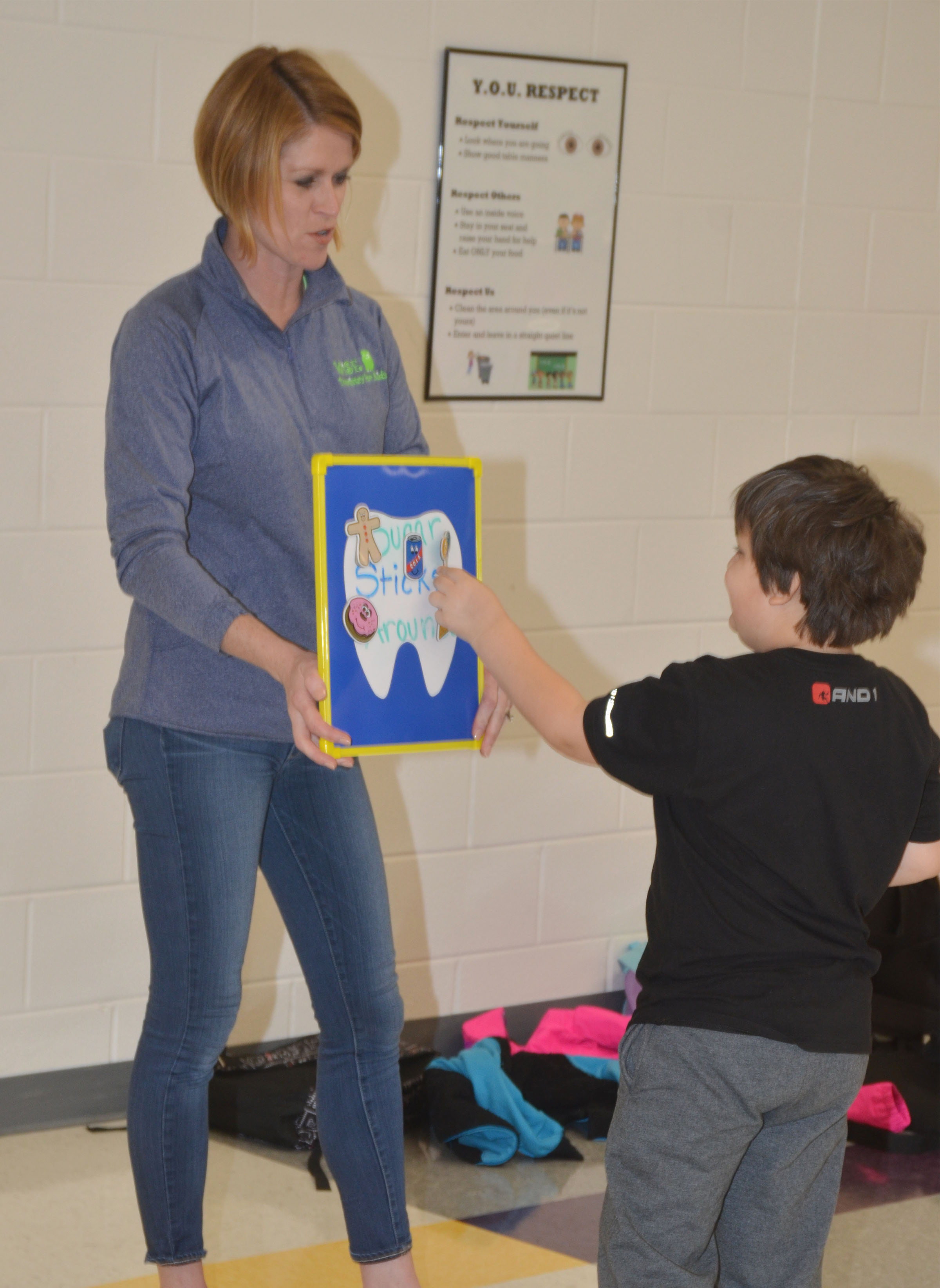 Dr. Heather Wise of Wise Dentistry for Kids asks CES kindergartener Cloud Malone if suckers are a good snack.