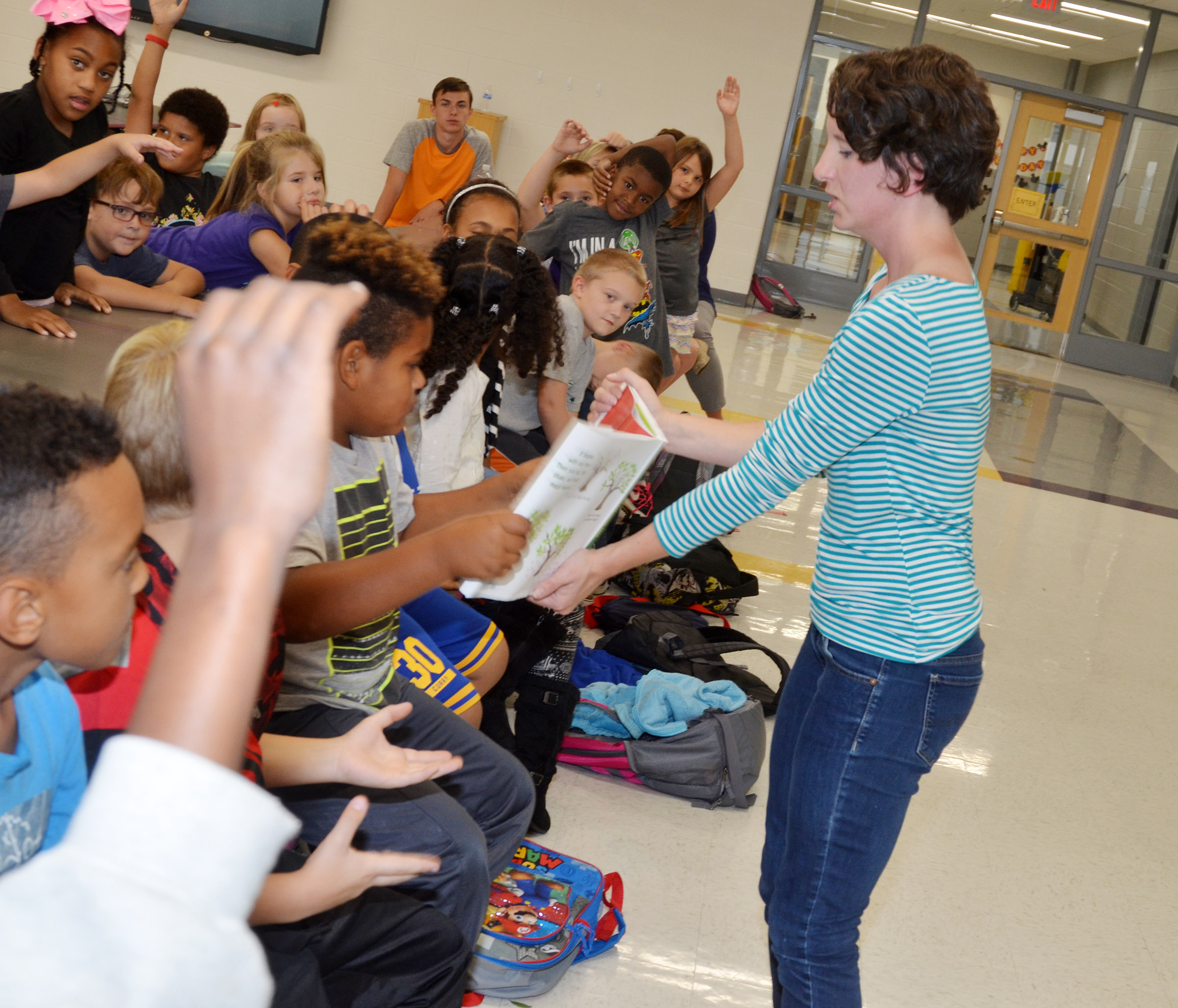 Kelsie Pepper from the Taylor County Public Library shows CES second-graders a book about leaves.
