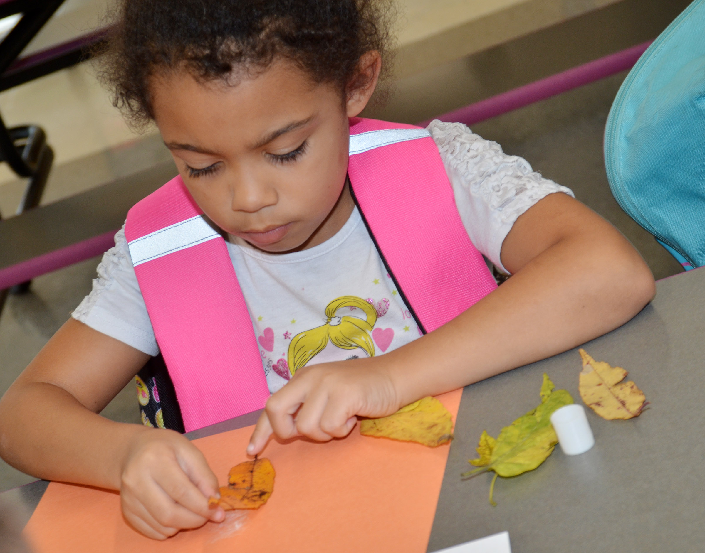 CES kindergartener Rylee Karr makes an animal out of leaves.