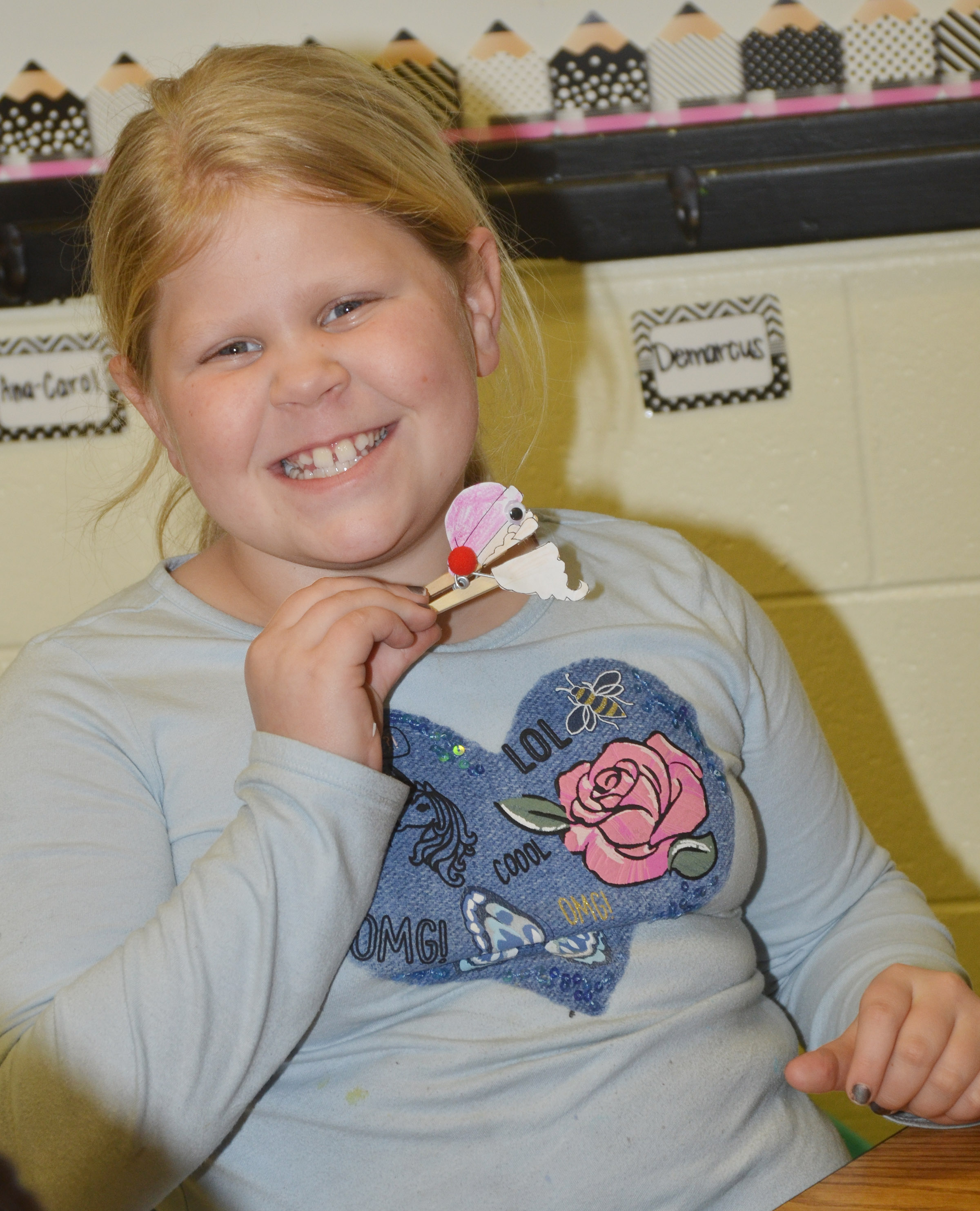 CES third-grader Lily Coots holds her Santa clothespin.