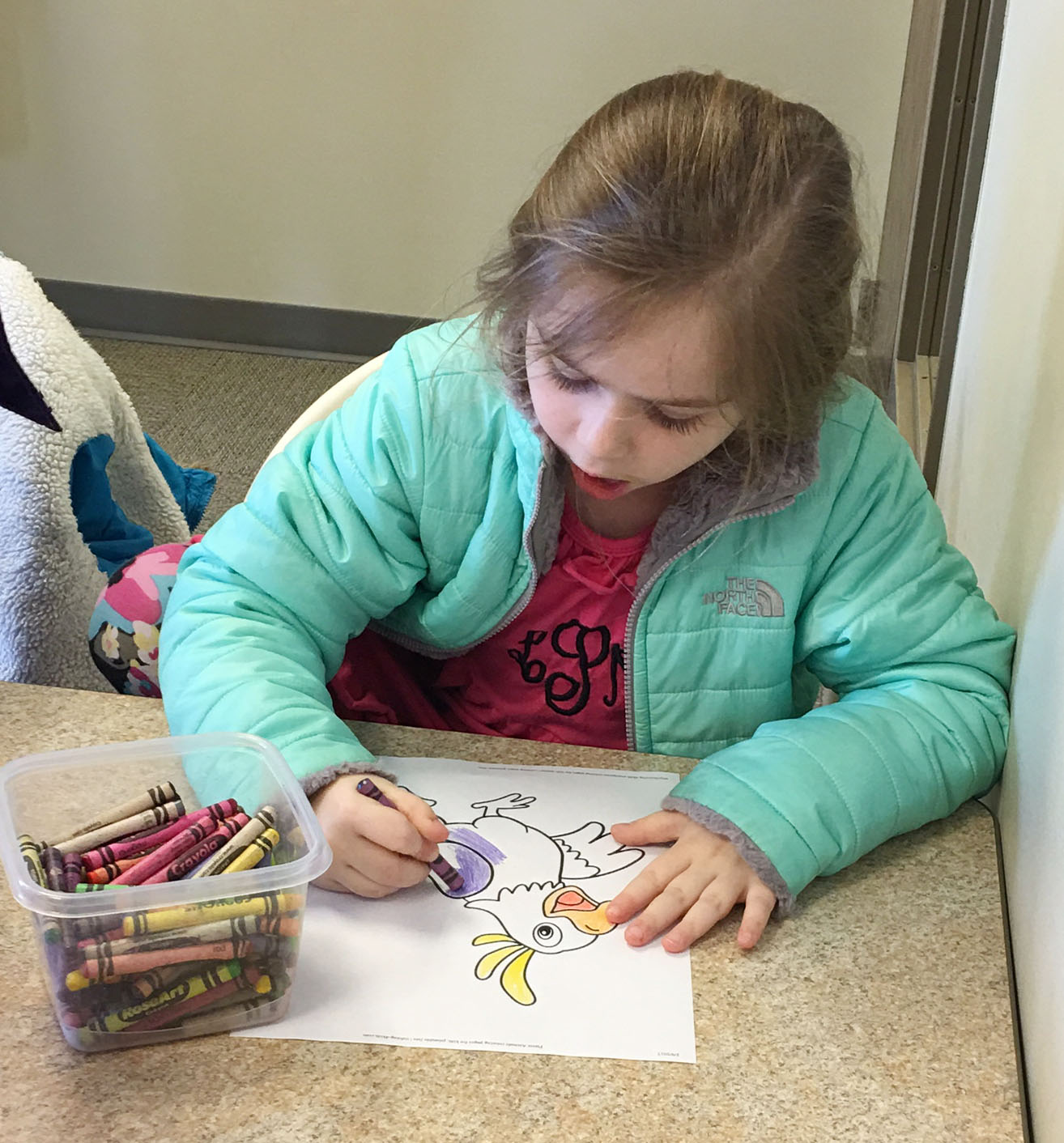 CES first-grader Lainey Price colors at the Taylor County Public Library.