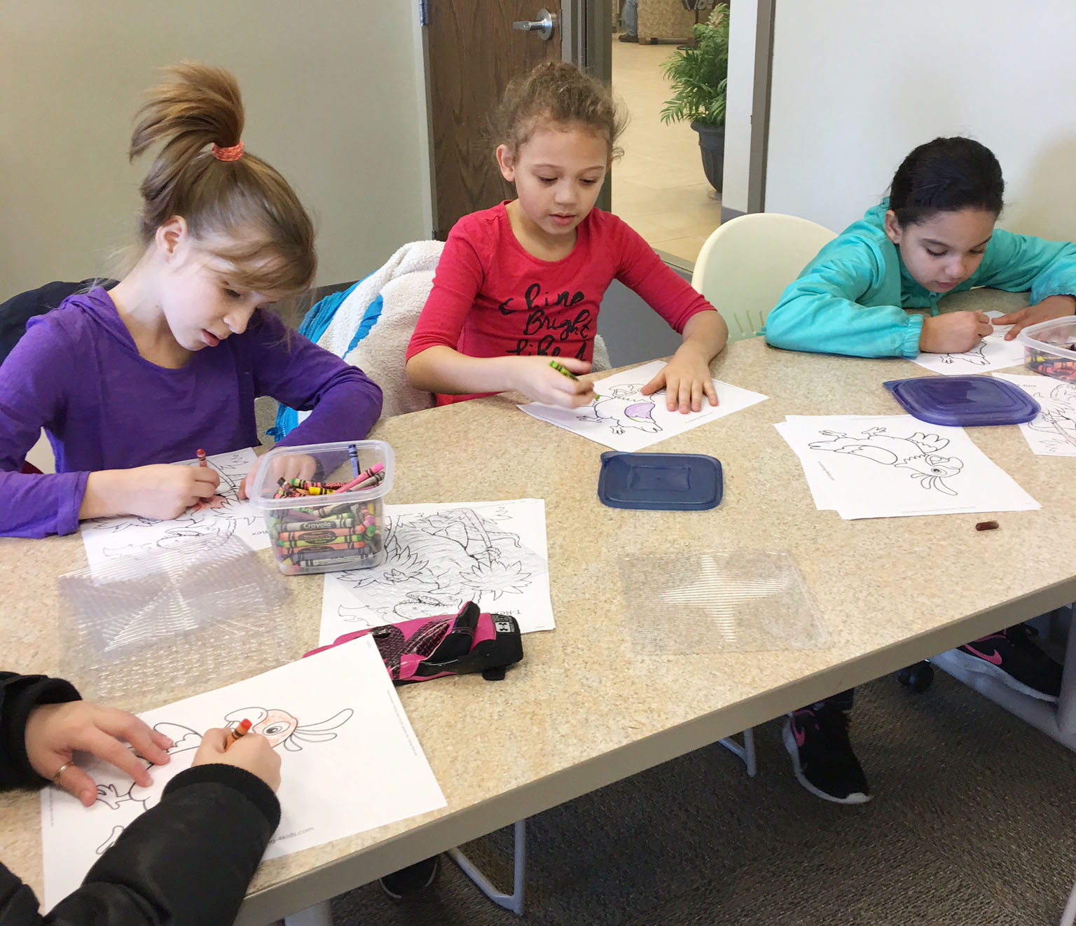 CES third-graders, from left, Raegan Hayes, Alicia Spaulding and Aleecia Knezevic color together.