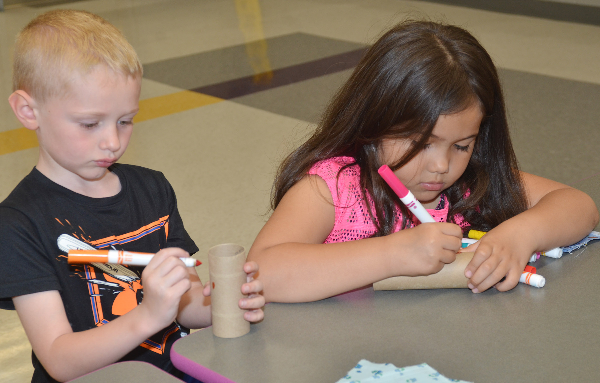 CES kindergarteners Jackson Wright, at left, and Hannah Matias decorate their maracas.