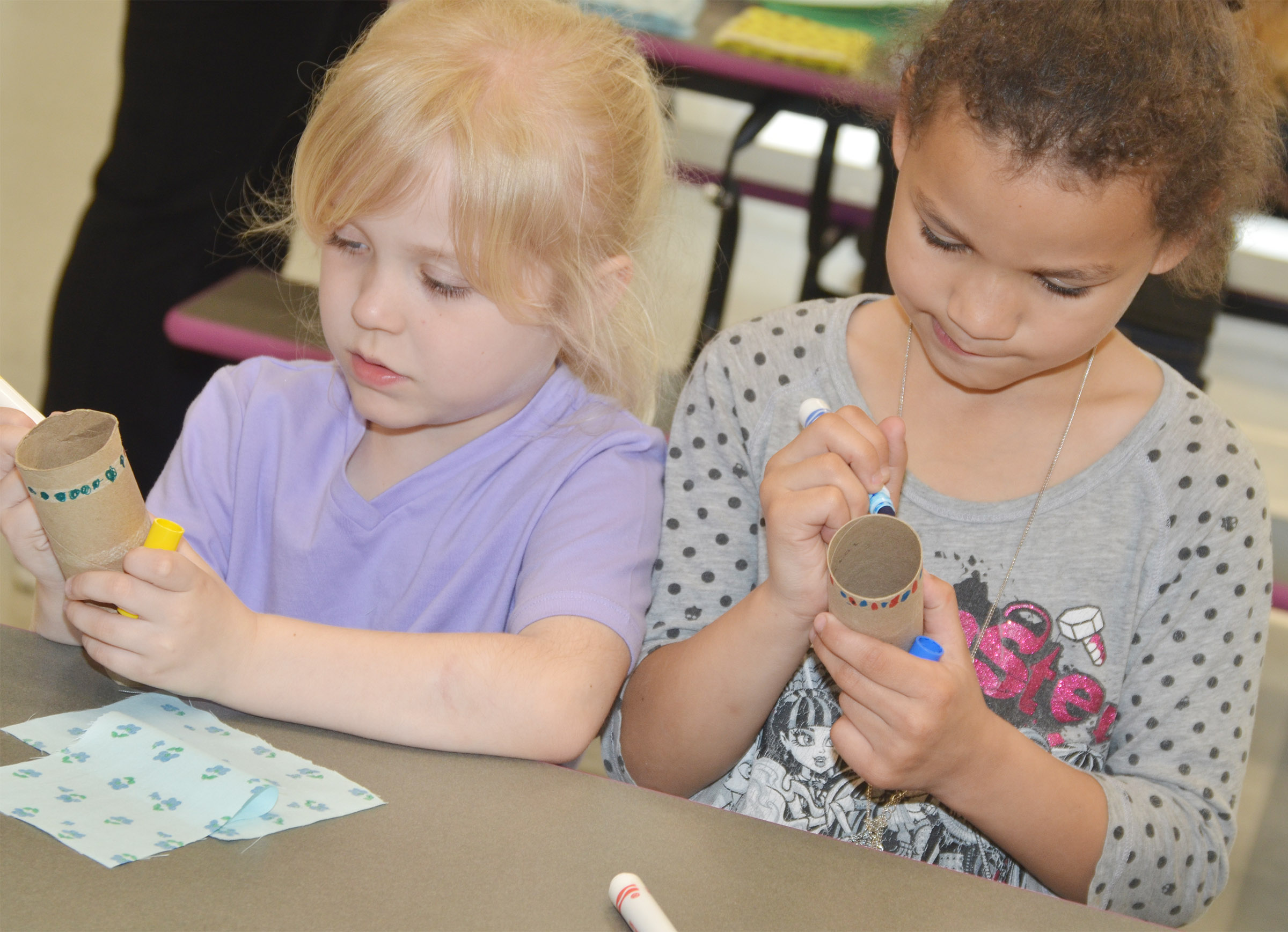 CES kindergarteners Ava Bennett-Marr, at left, and Aleeya Spaulding decorate their maracas.