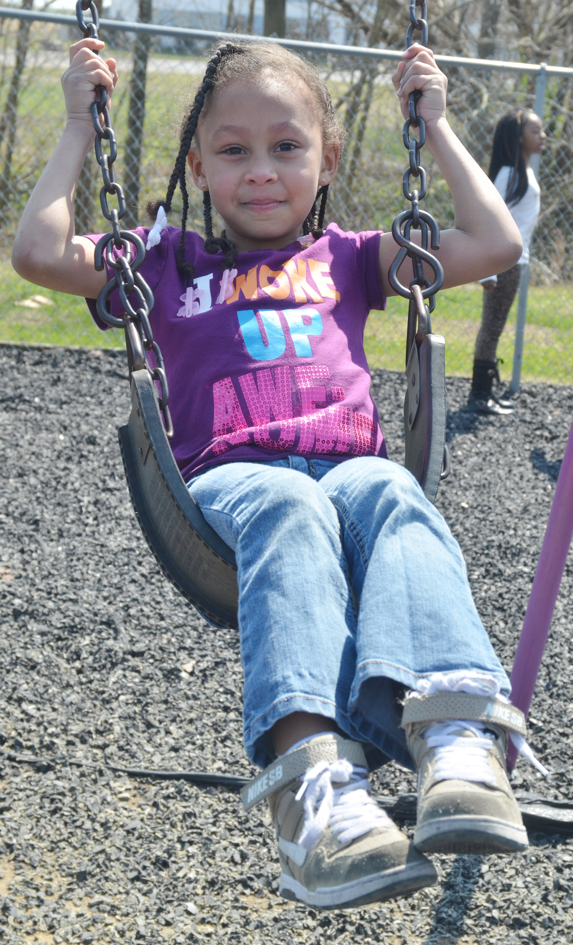 CES kindergartener Elyzabeth Fisher swings.