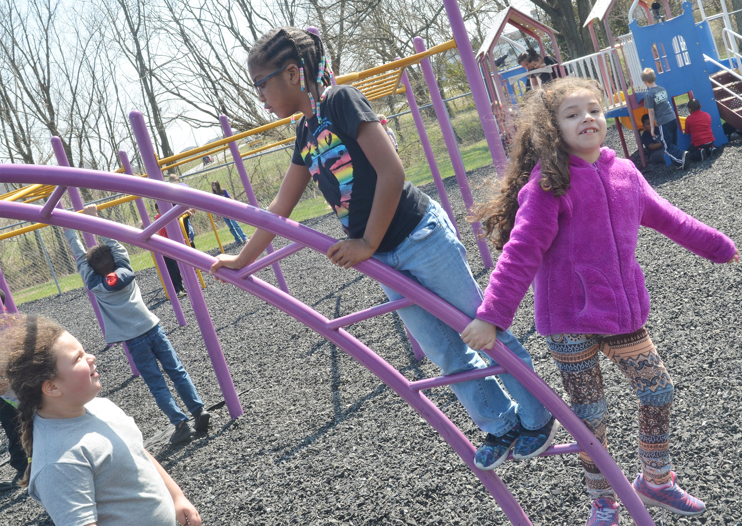 CES first-graders, from left, Amylah Taylor, Willow Griffin and Ammarissa Nunez climb together.