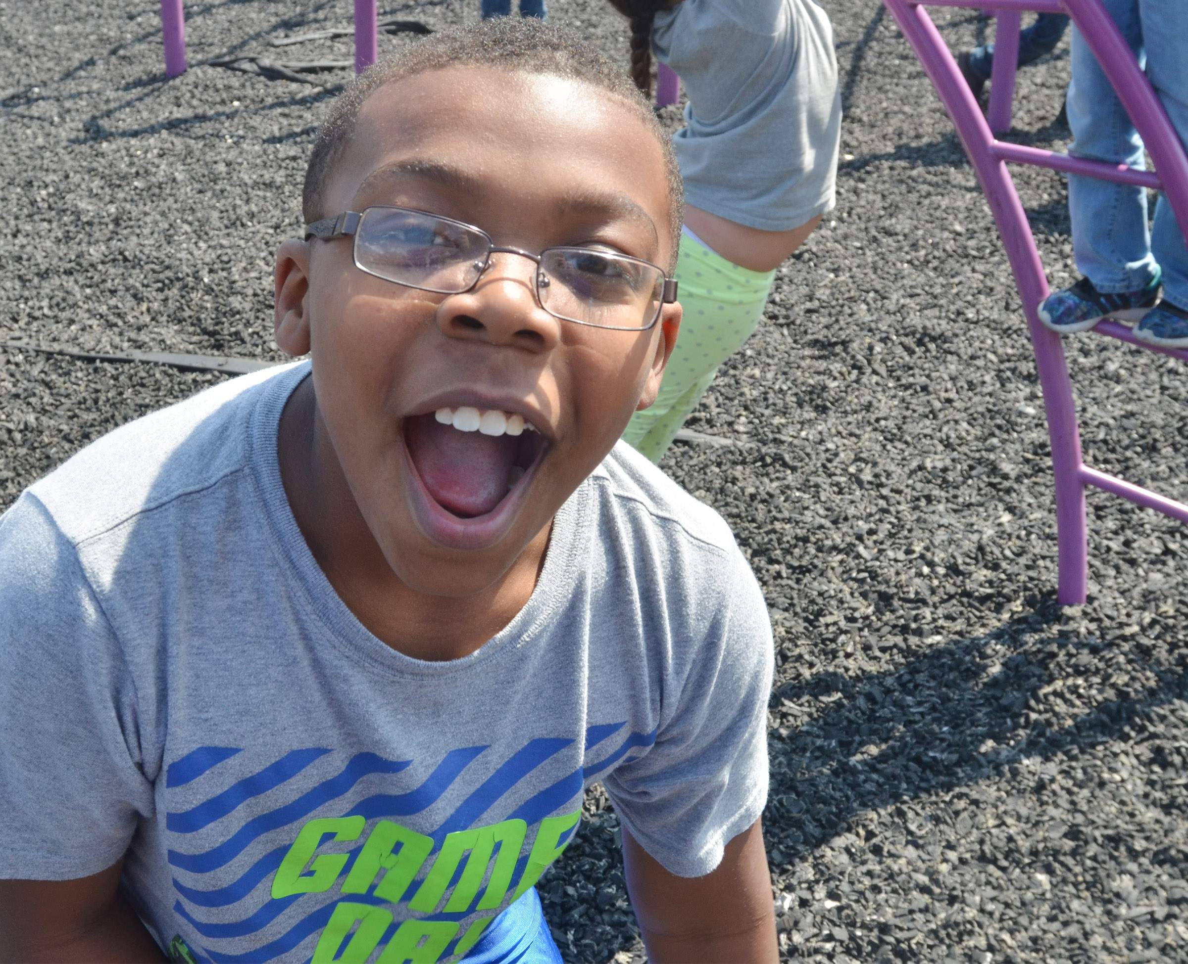 CES third-grader Austin Sloan laughs as he runs around the playground.