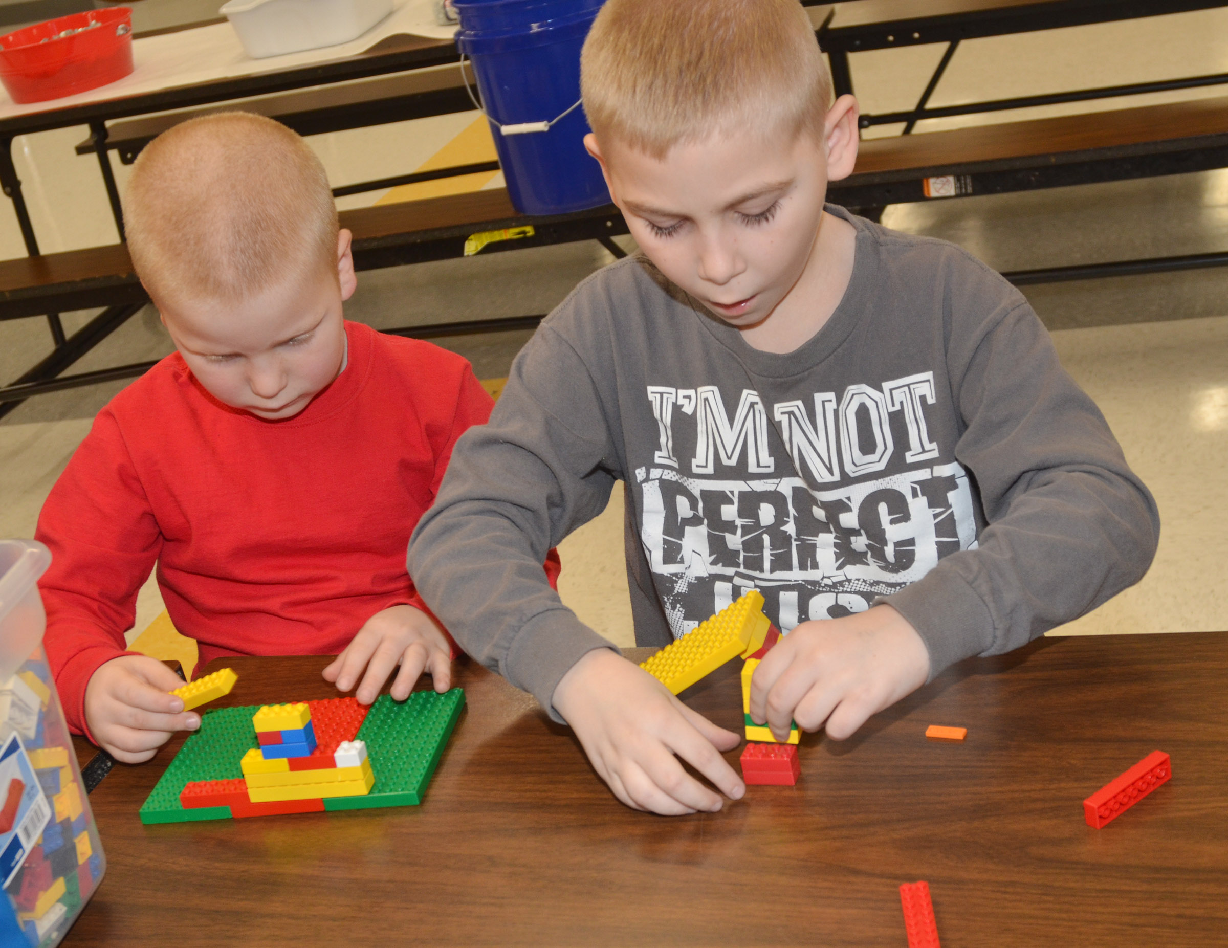 CES first-grader Ben Parrott, at left, and second-grader Joseph Greer build with Legos.