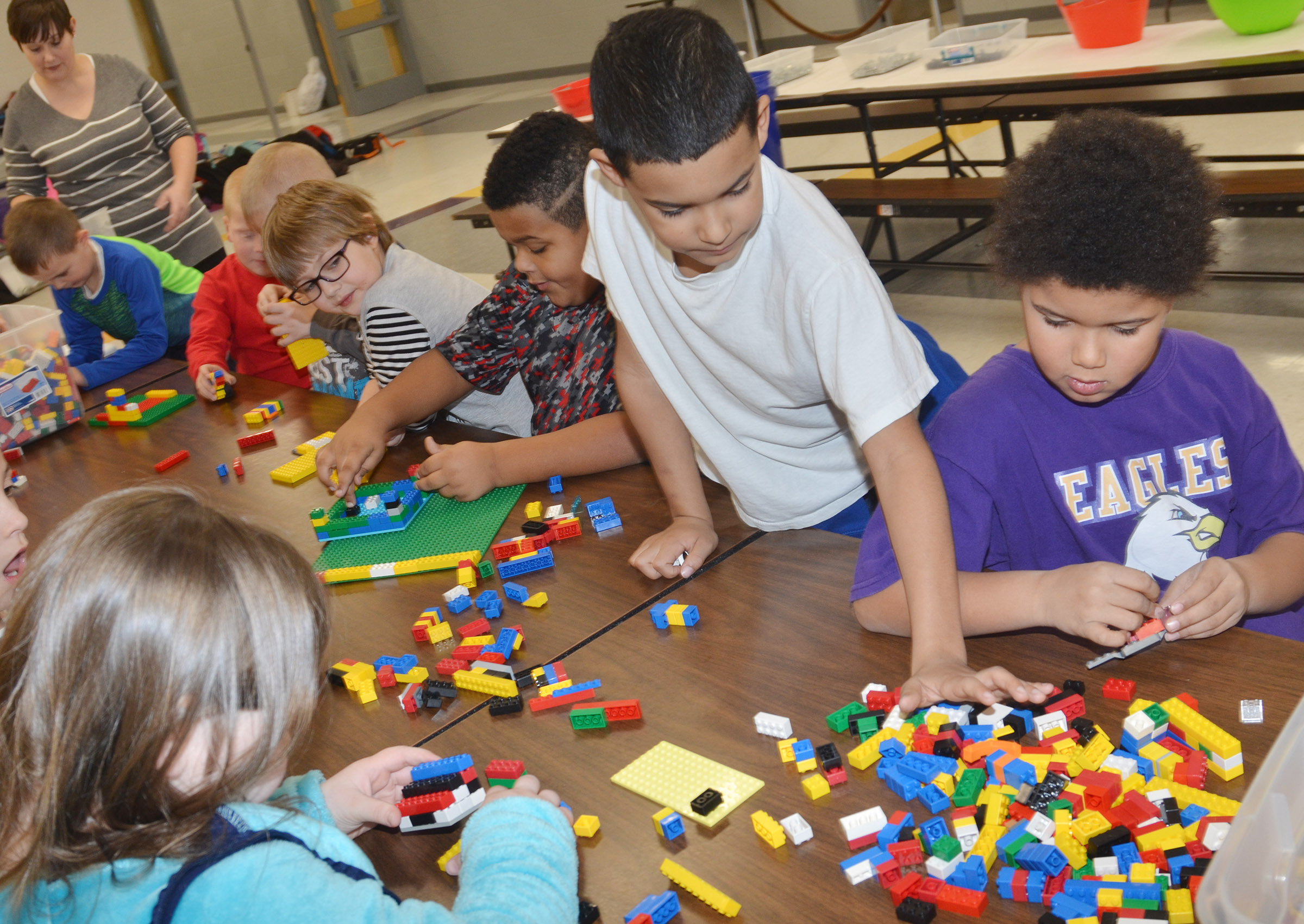 CES first-grader Rizzo McKenzie, center, and first-grader Navon Copeland and their classmates build with Legos.