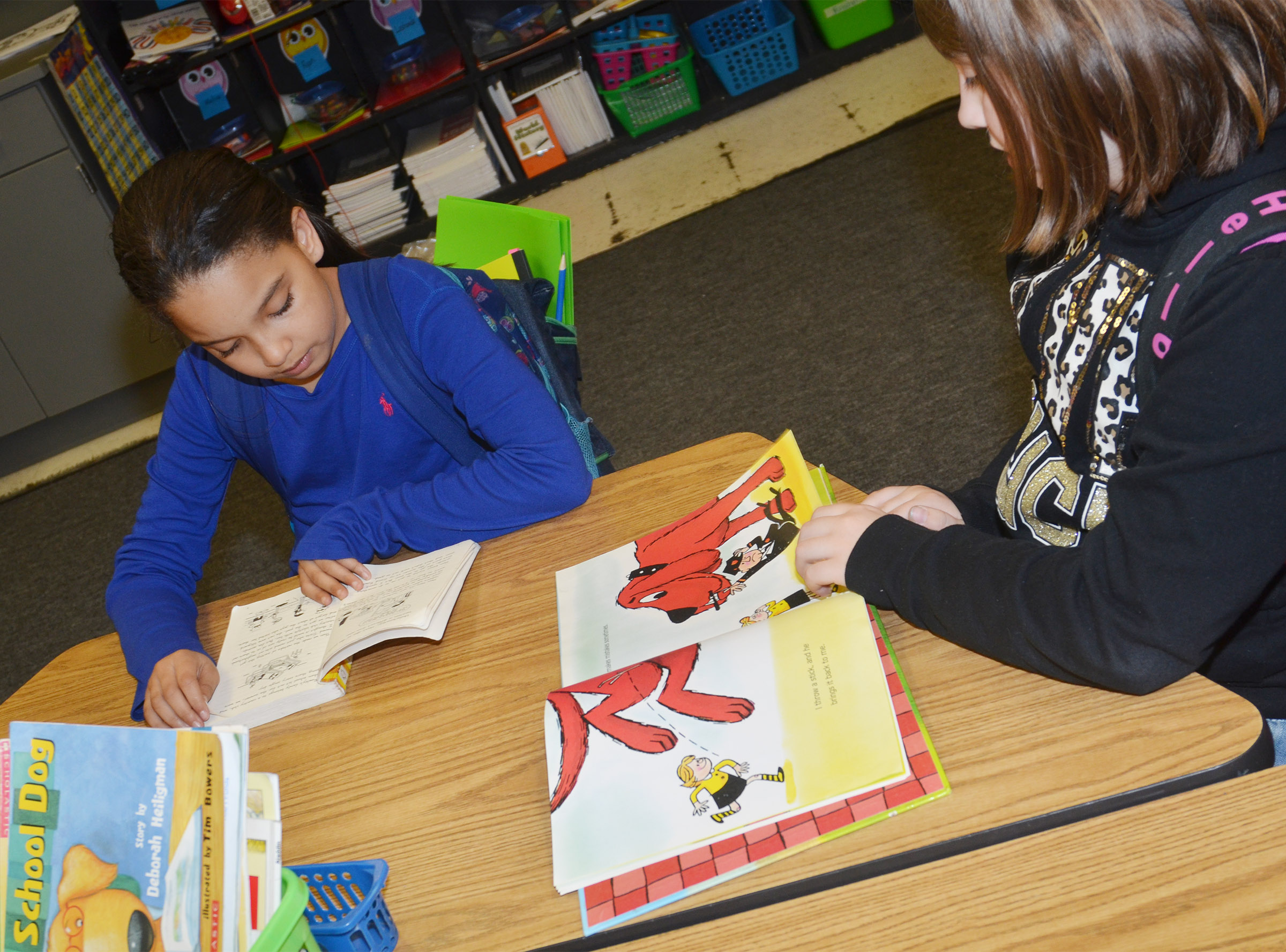 CES third-graders Aleecia Knezevic and Adrianna Garvin read together at Wings Express.