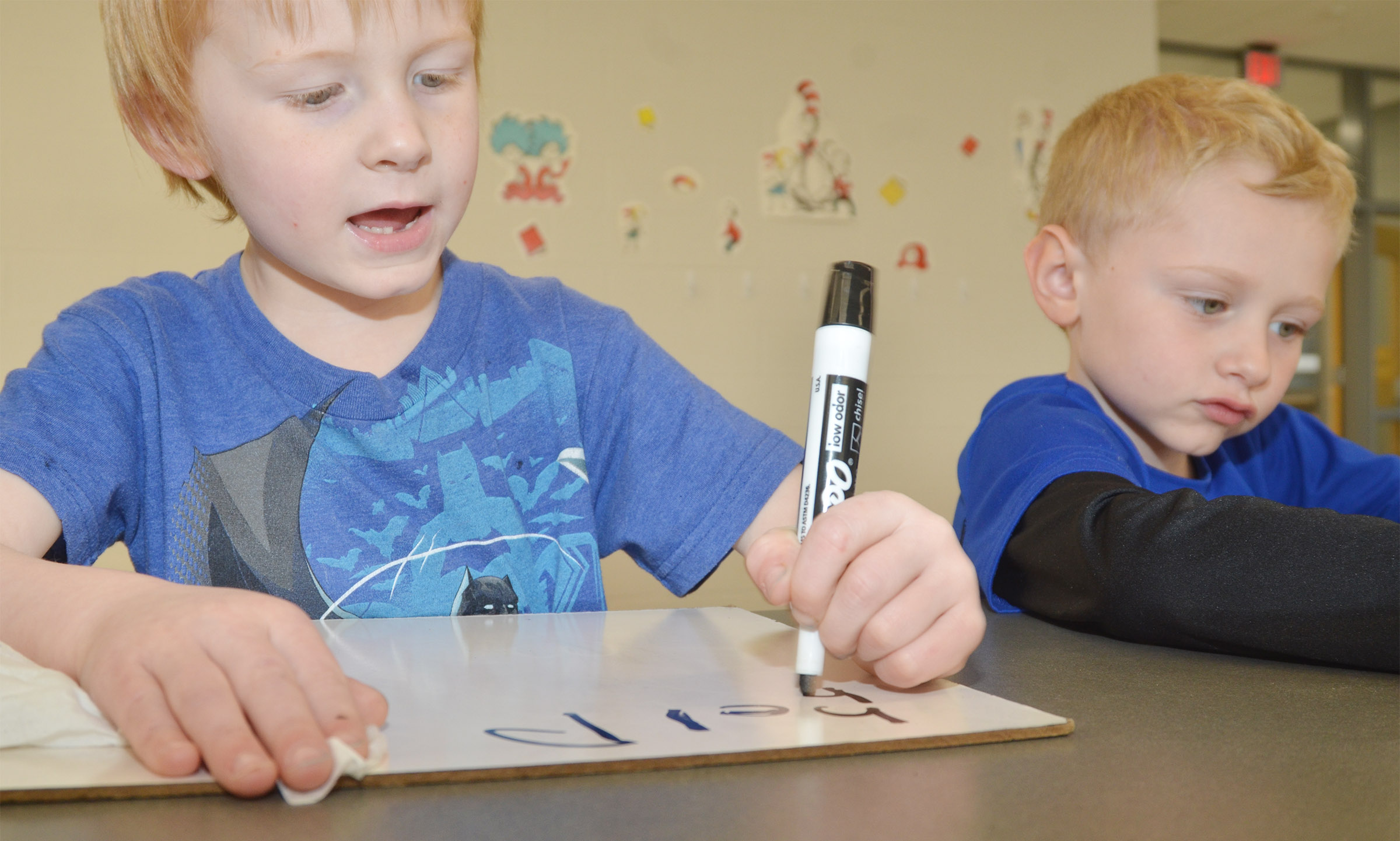 "CES kindergarteners Jayden Maupin, at left, and Jackson Wright write the word ""help."""