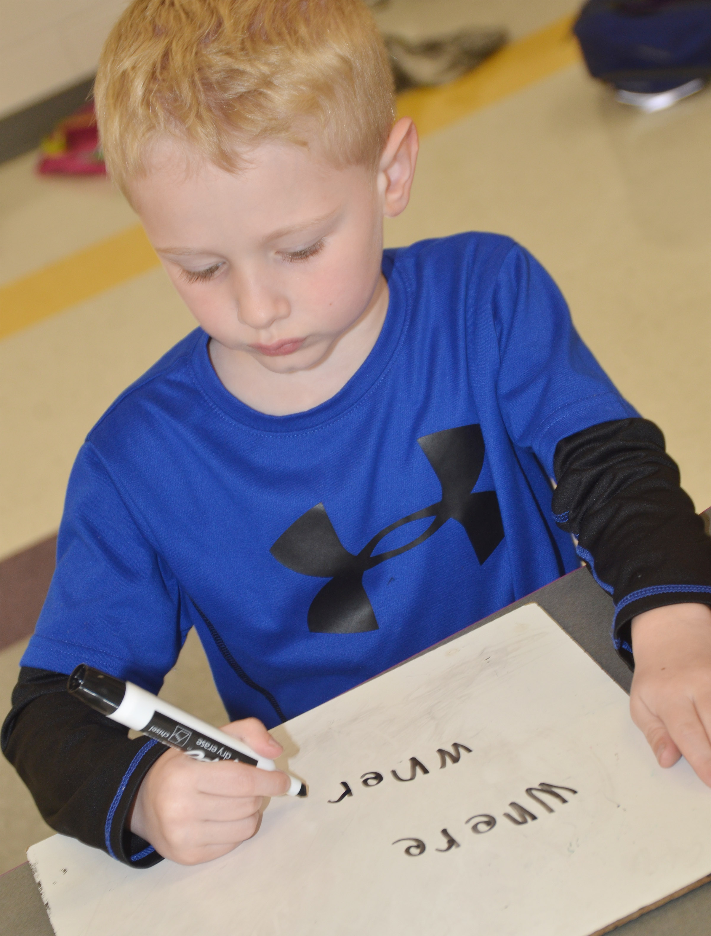 "CES kindergartener Jackson Wright writes the word ""where."""