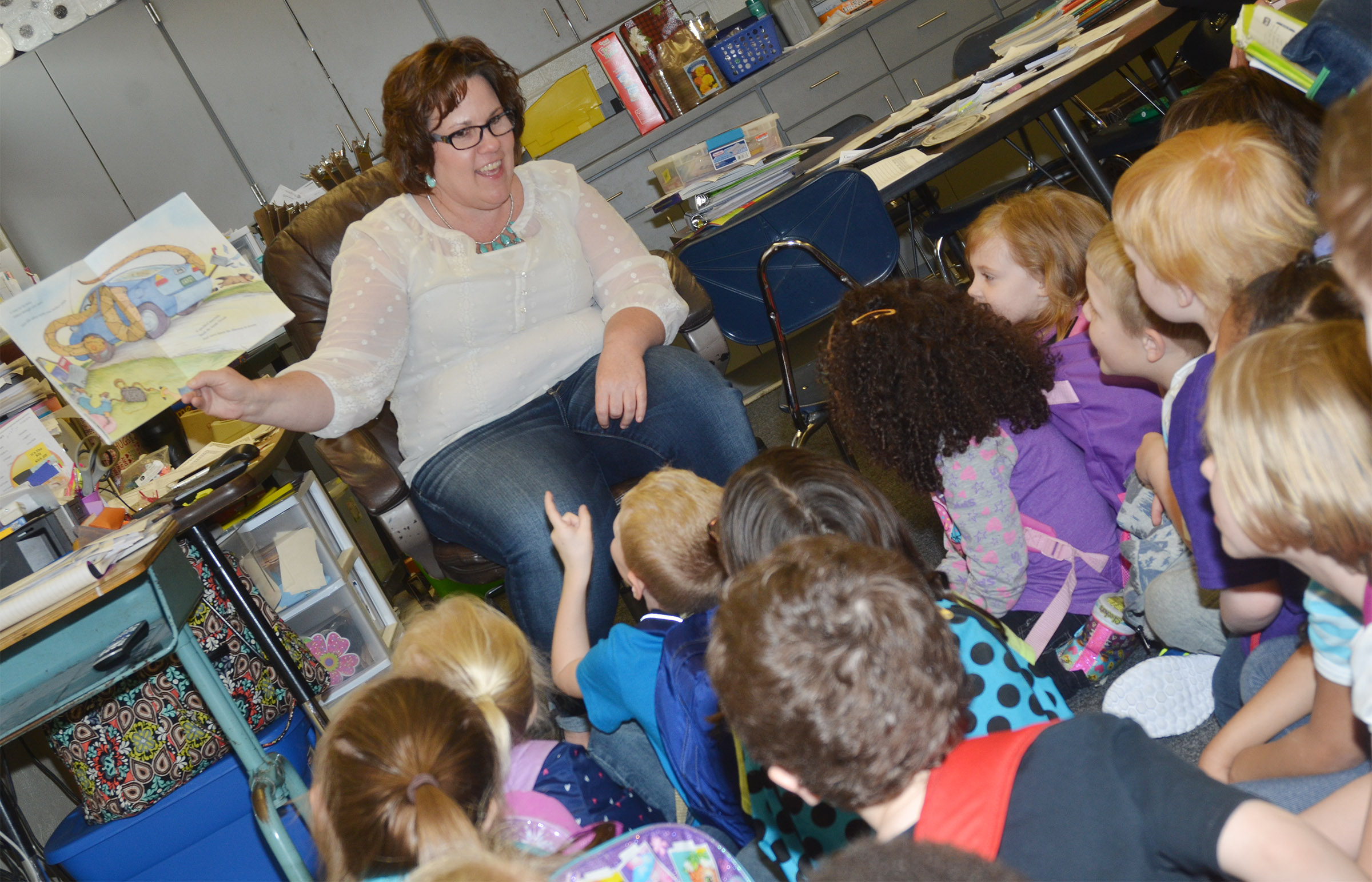 CES second-grade teacher Tracey Rinehart reads a book about snakes.